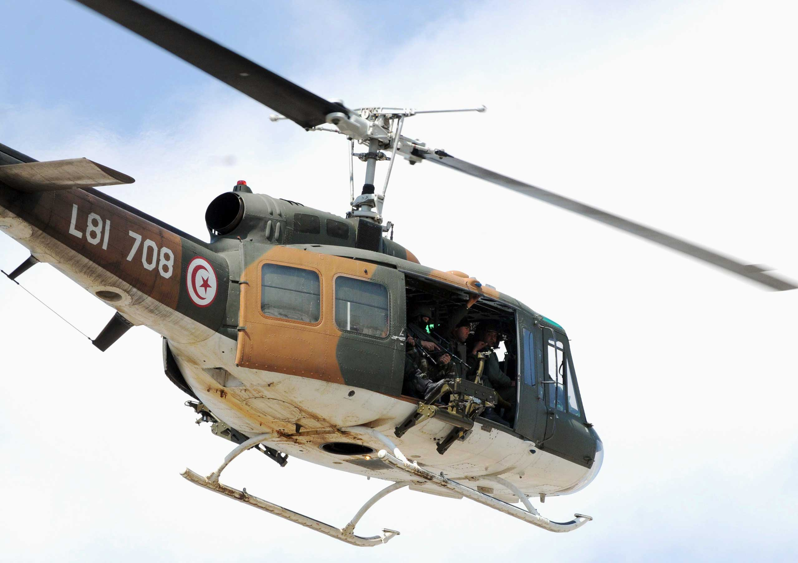 A Tunisian security force helicopter flies over the site of an attack carried out by two gunmen at the Bardo Museum in Tunis on March 18, 2015.