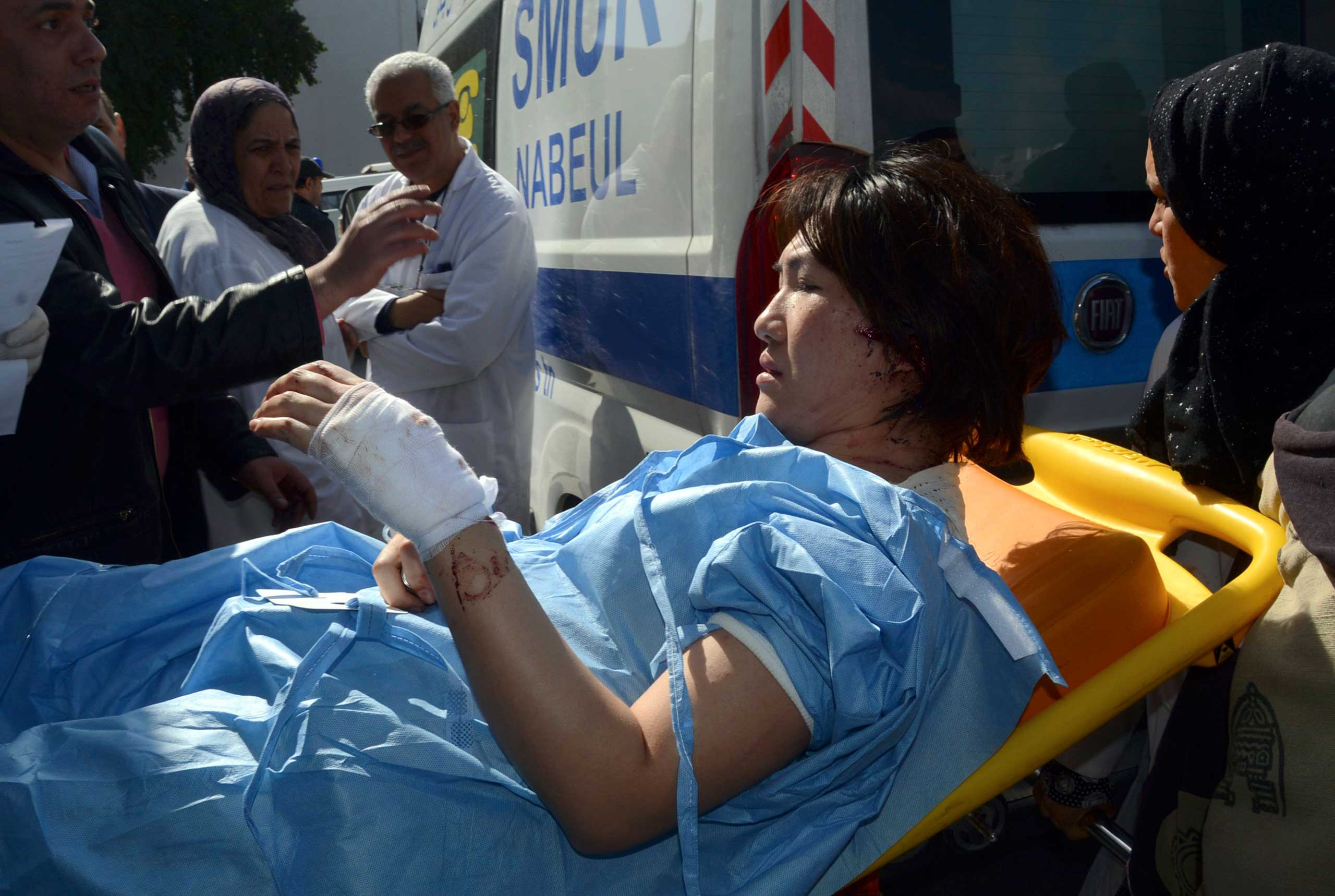 A victim arrives at the Charles Nicoles hospital, March 18, 2015 in Tunis.