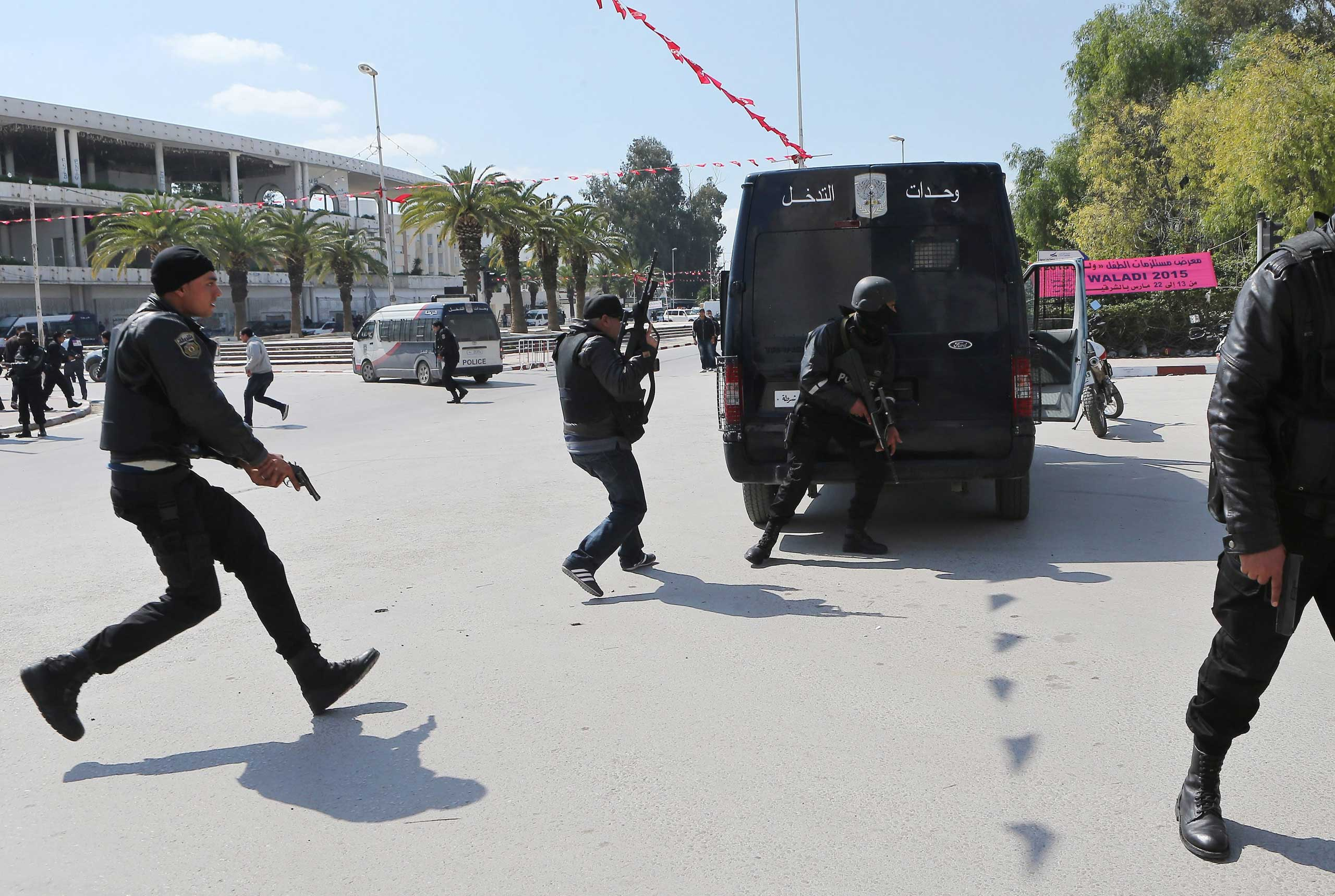 Members of the Tunisian security services take up a position after gunmen reportedly took hostages near the country's parliament, outside the Bardo Museum in Tunis, March 18, 2015.