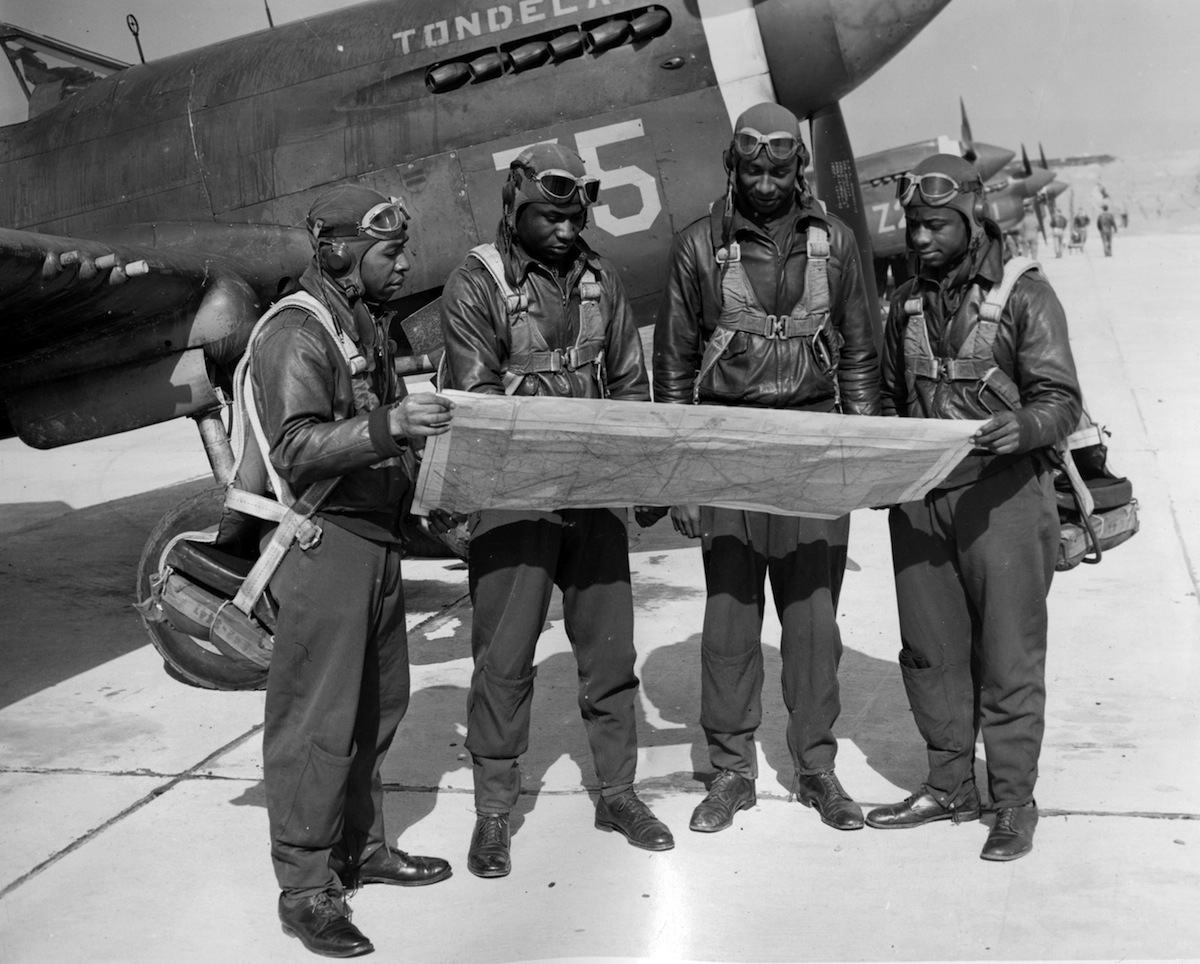 Tuskegee Airmen studying maps in Tuskegee, Ala., 1942.