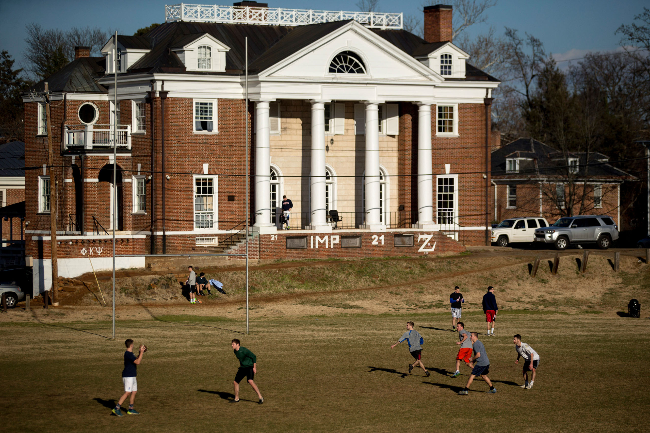 Students play football on the Madison Bowl field of the University of Virginia (UVA) campus next to the Phi Kappa Psi fraternity in Charlottesville, Va., on Jan. 16, 2015.