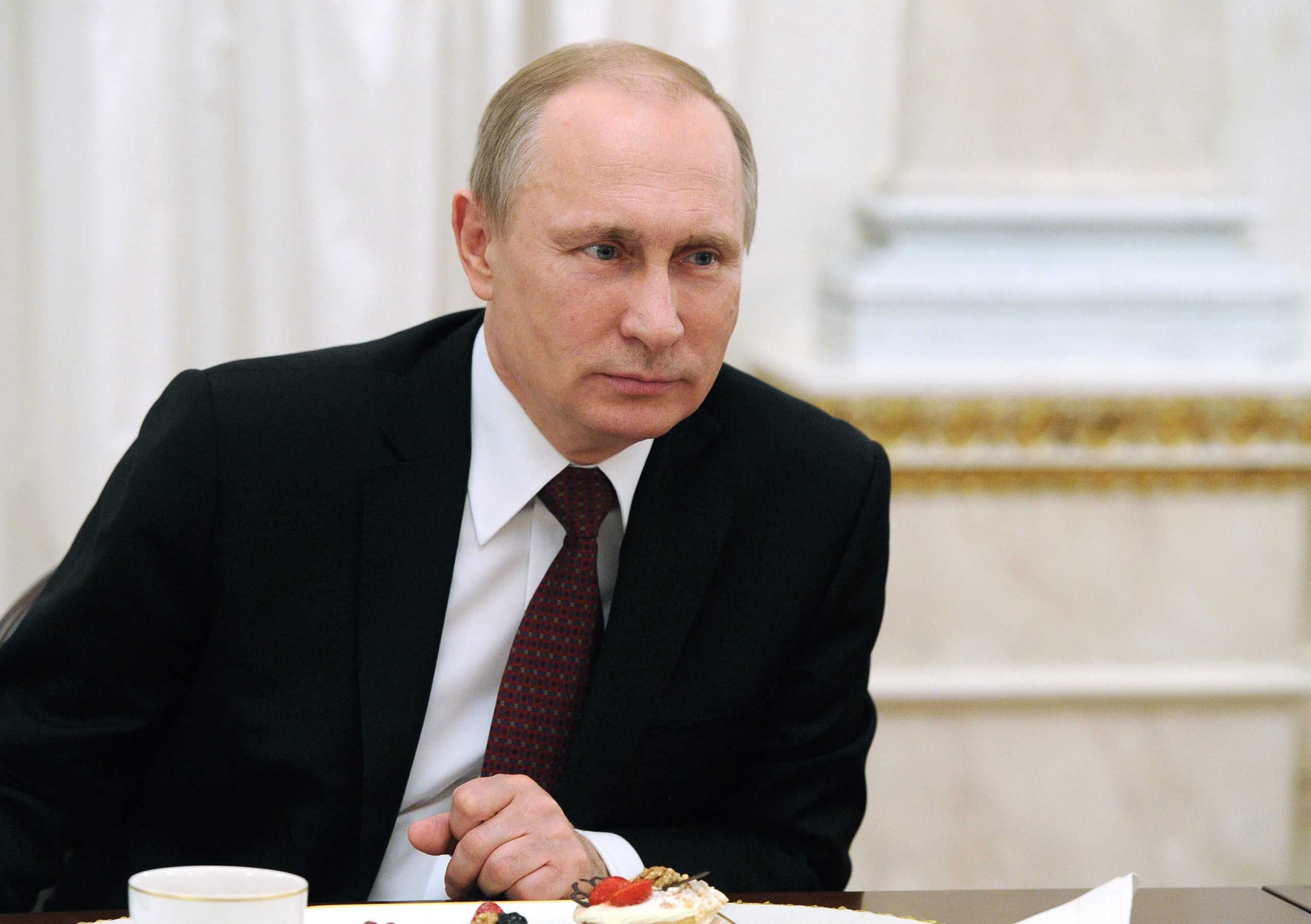Russian President Vladimir Putin during a meeting with mothers whose children achieved outstanding results in art, science, sport and were also given the ranks of Heroes of Russia in Moscow on March 8, 2015.