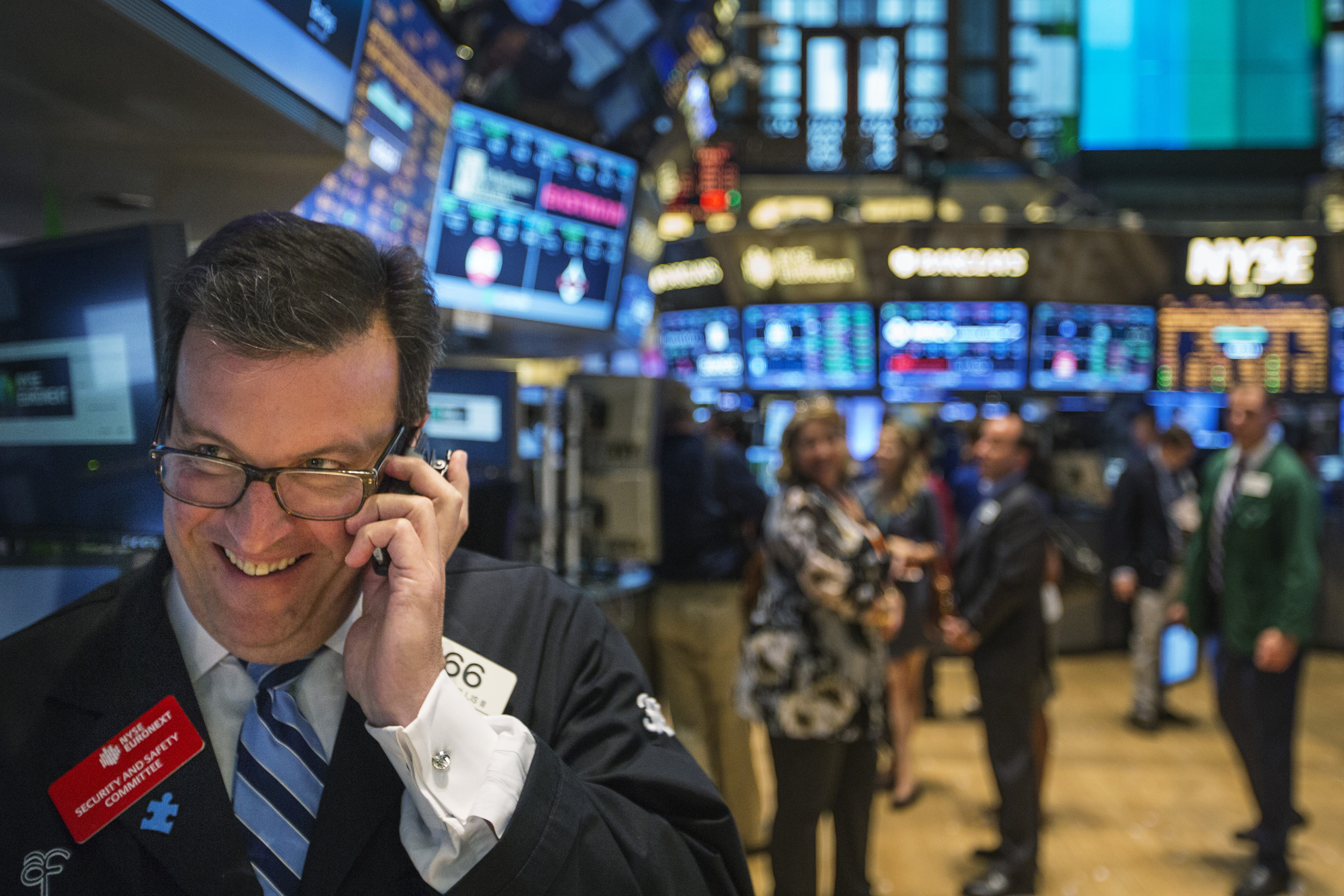A trader works on the floor of the New York Stock Exchange shortly before the end of the day's trading in New York July 31, 2013