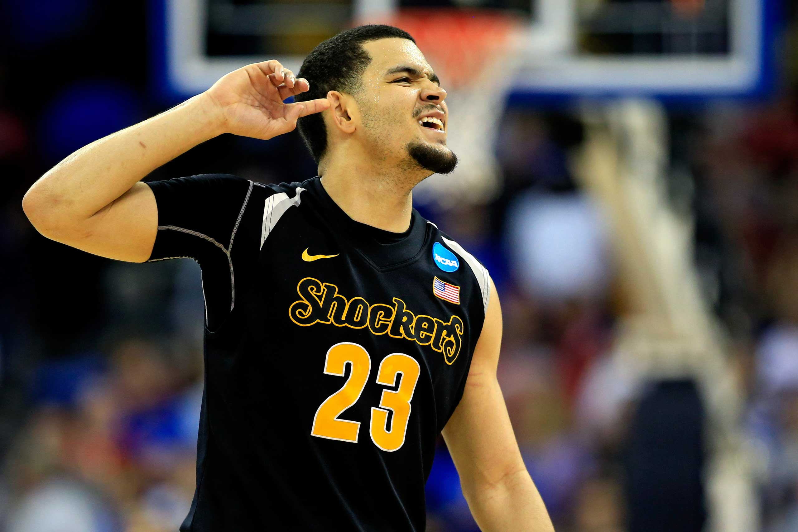Fred VanVleet of the Wichita State Shockers celebrates as the second half ends against the Kansas Jayhawks during the third round of the 2015 NCAA Men's Basketball Tournament at the CenturyLink Center in Omaha, Neb. on March 22, 2015.