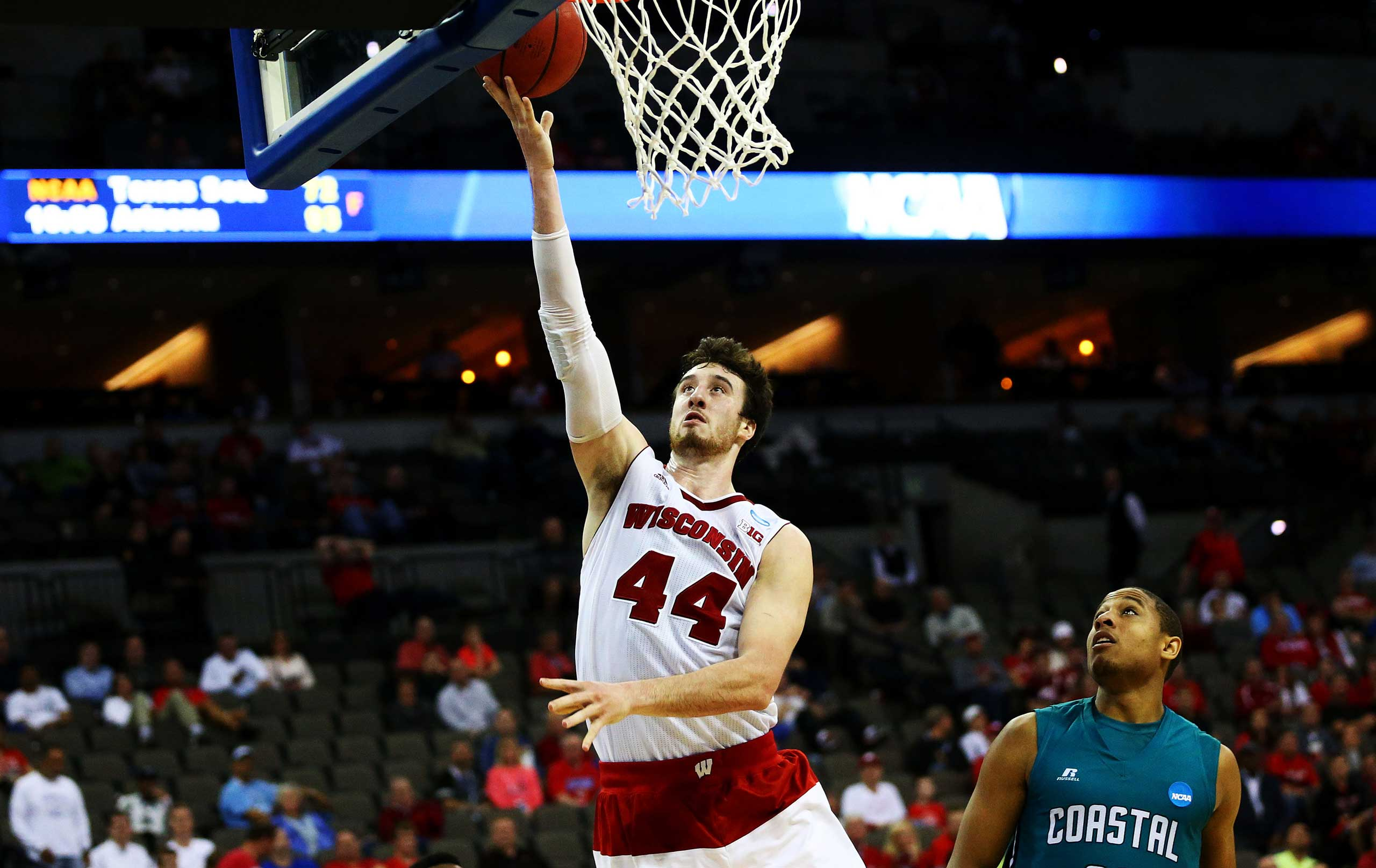 Frank Kaminsky of the Wisconsin Badgers shoots against the Coastal Carolina Chanticleers in the second half during the second round of the 2015 NCAA Men's Basketball Tournament at the CenturyLink Center in Omaha, Neb. on March 20, 2015.
