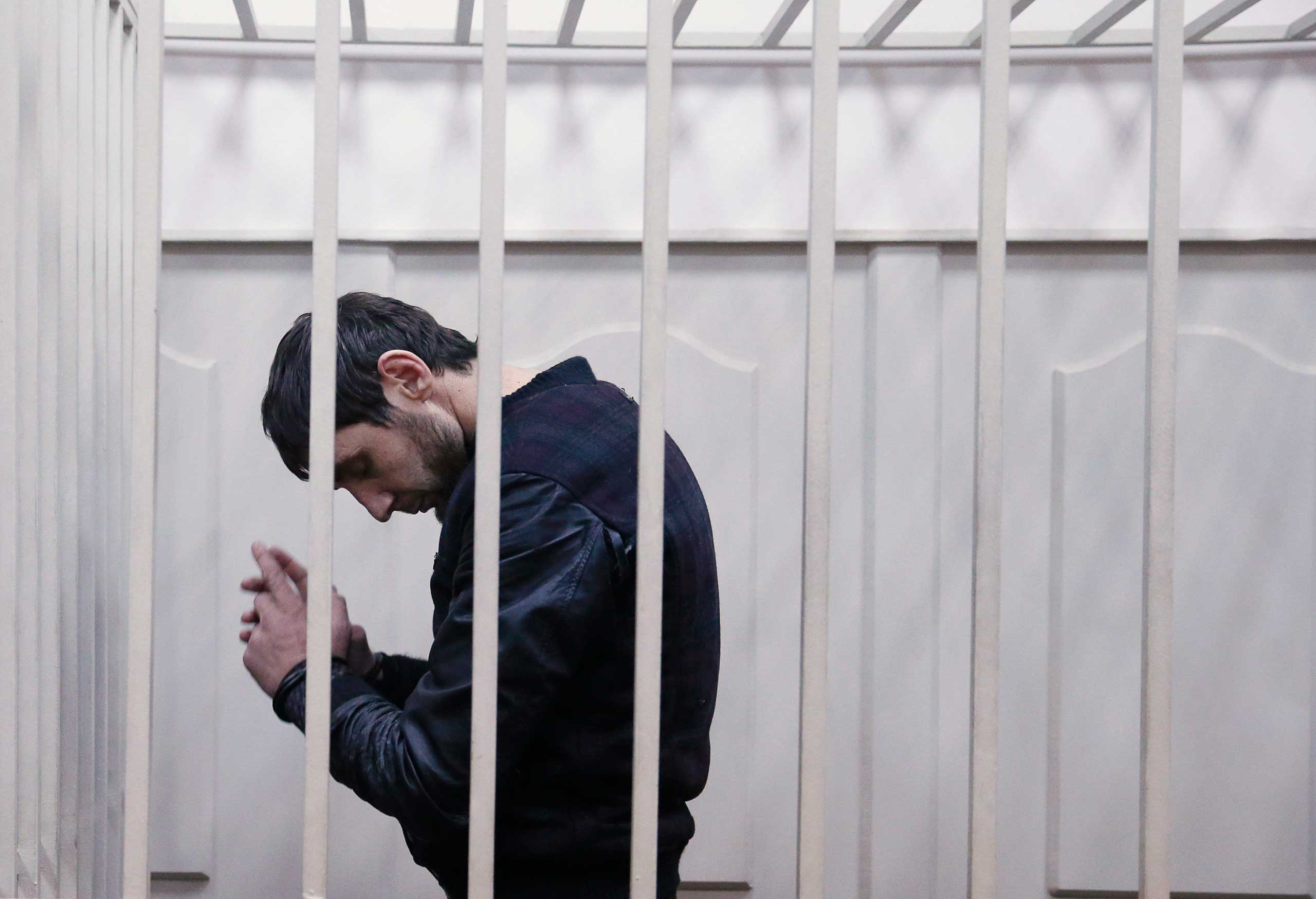 Zaur Dadayev, charged over the killing of Russian opposition figure Boris Nemtsov, stands inside a defendants' cage inside a court building in Moscow, March 8, 2015.