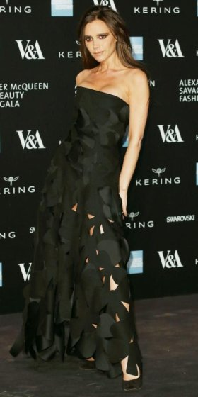 MARCH 12, 2015 Beckham got down and broody at the Alexander McQueen Savage Beauty Gala in a dramatic strapless floral cut-out gown of her own design, complete with smoldering eye makeup and black Casadei pumps.