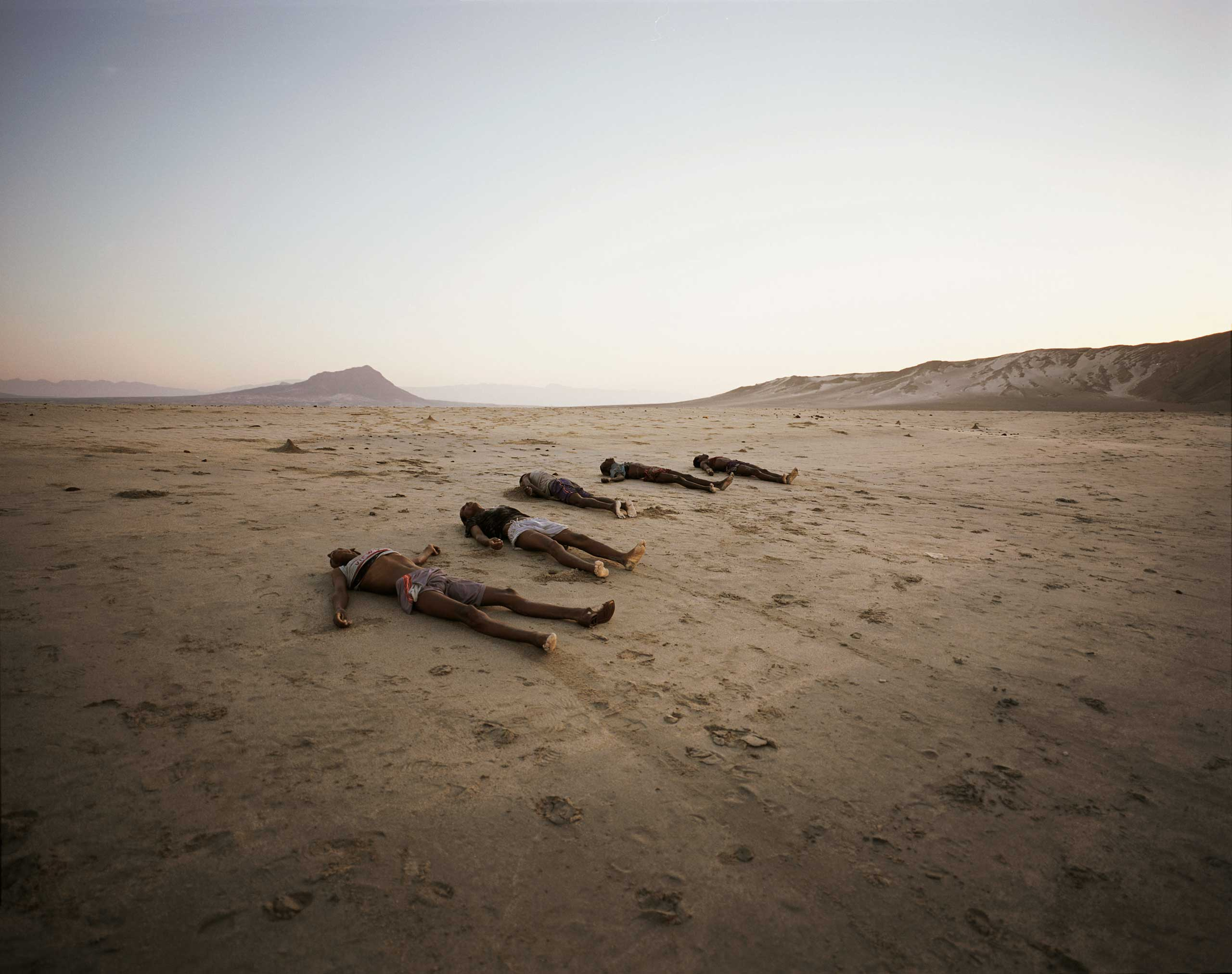 A row of corpses line Al-Baida Beach in Bir Ali, Yemen, May 2, 2007. A total of 34 bodies were found. Just one week after an almost identical tragedy saw 30 dead on a nearby beach, Somali smugglers continued to drop their human cargo out at sea rather than coming close to shore and risking detection.