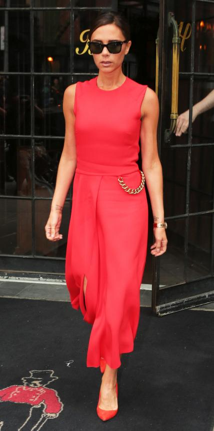 JUNE 10, 2014 Beckham opted for a vibrant red jumpsuit accented with a gold chain as she hit the streets in New York City.