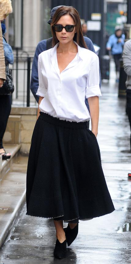 SEPTEMBER 29, 2014 The street style star rocked a chic oversized ensemble made up of a crisp white shirt and black bottoms while out in London.