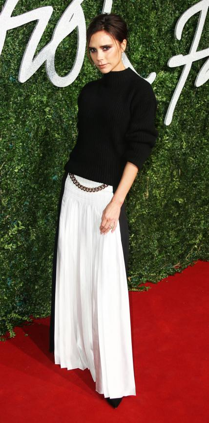 DECEMBER 1, 2014 At the British Fashion Awards, Beckham took home brand of the year in one of her own black-and-white designs.