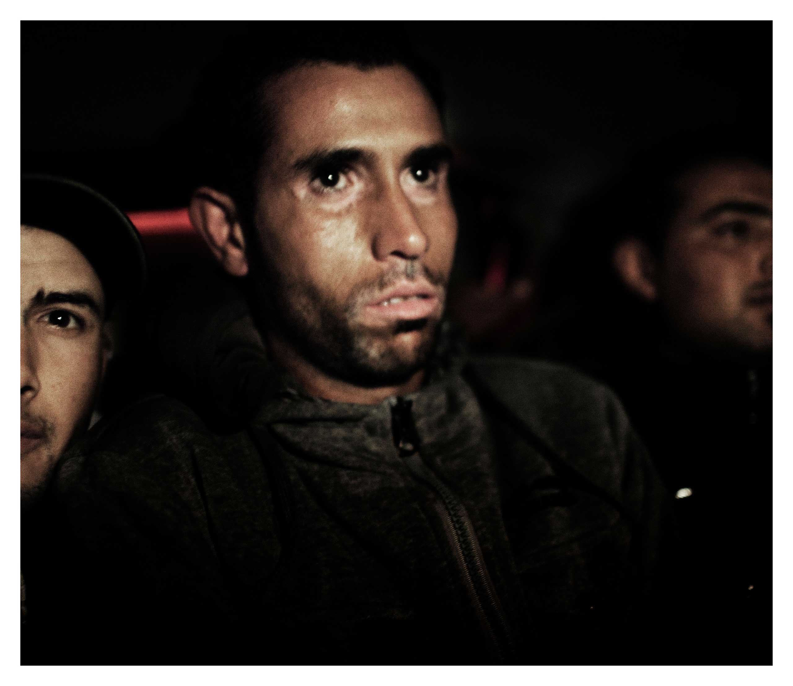 Migrants get ready to board the boat to reach Italy from the coast of Zarzis, Tunisia, March 13, 2011.