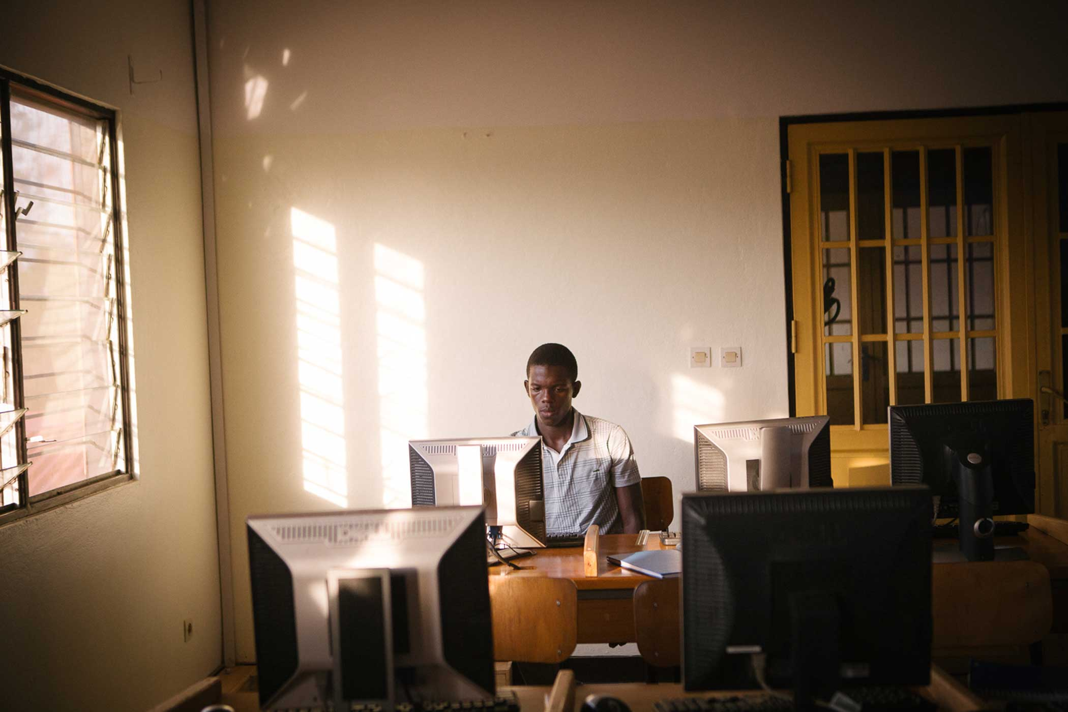 A S.O.S. Kagugu Technical High School student during an after school coding club run by HeHe Lab's youth fellows.