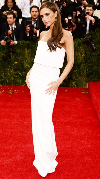 MAY 5, 2014 Beckham attended the 2014 Costume Institute Gala at the Metropolitan Museum of Art in New York City wearing a stunning white gown from her own label.