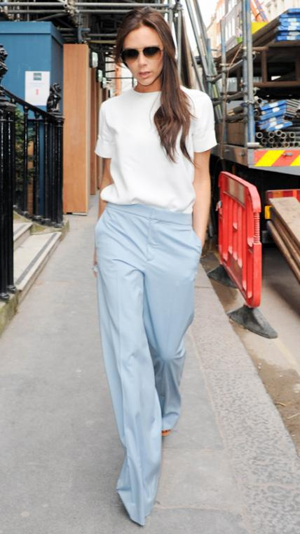 MARCH 20, 2014 Beckham ran errands in London wearing a cream top and light blue wide-leg trousers, which she paired with aviator sunnies.