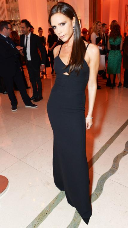 NOVEMBER 5, 2013 At the 2013 Harper's Bazaar Women of the Year Awards at London's Claridge's Hotel, Beckham chose a peekaboo black gown and minimalistic accessories.
