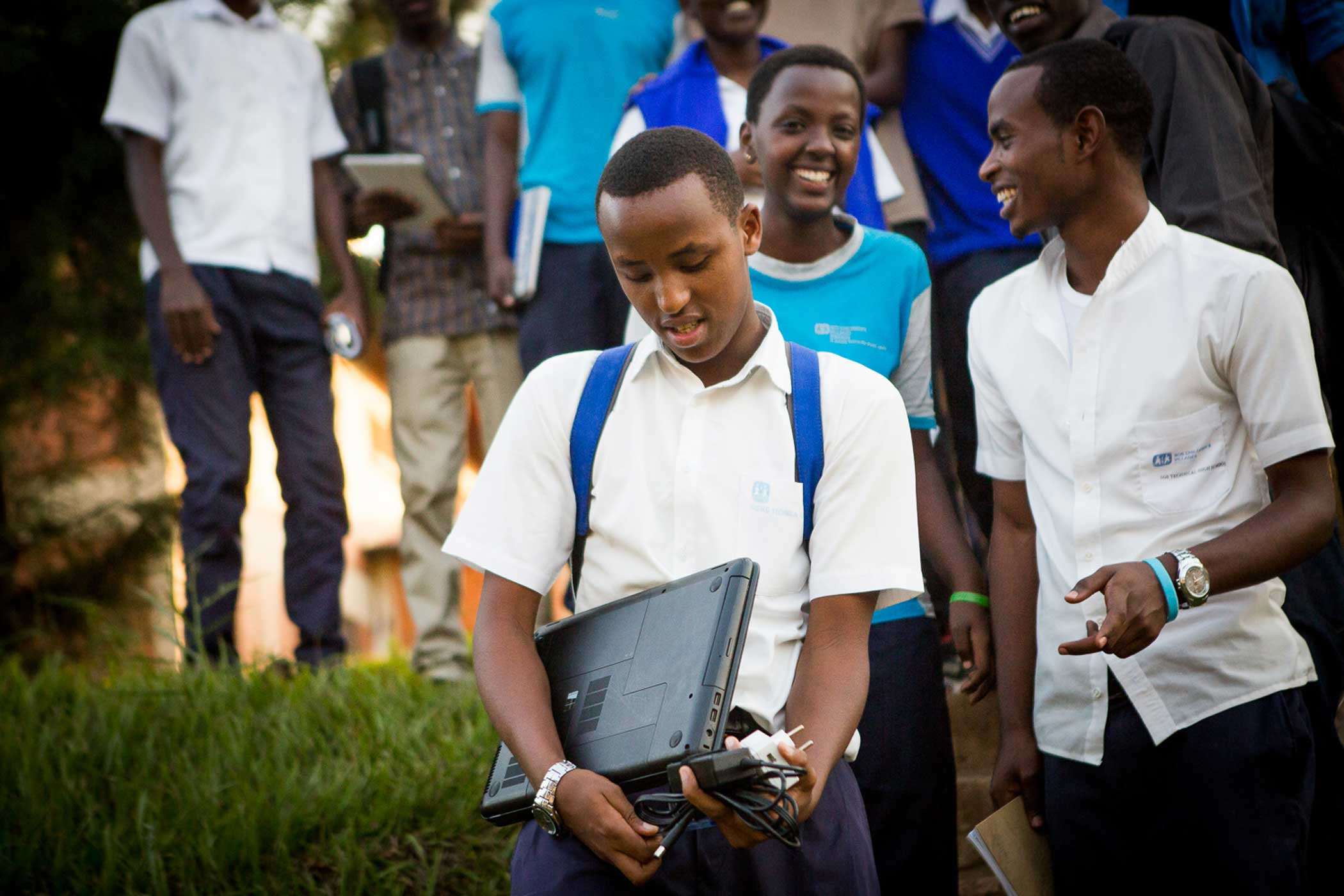 Elisée Pax Mfura, 18, and his classmates leave the after-school program run by HeHe Labs.
