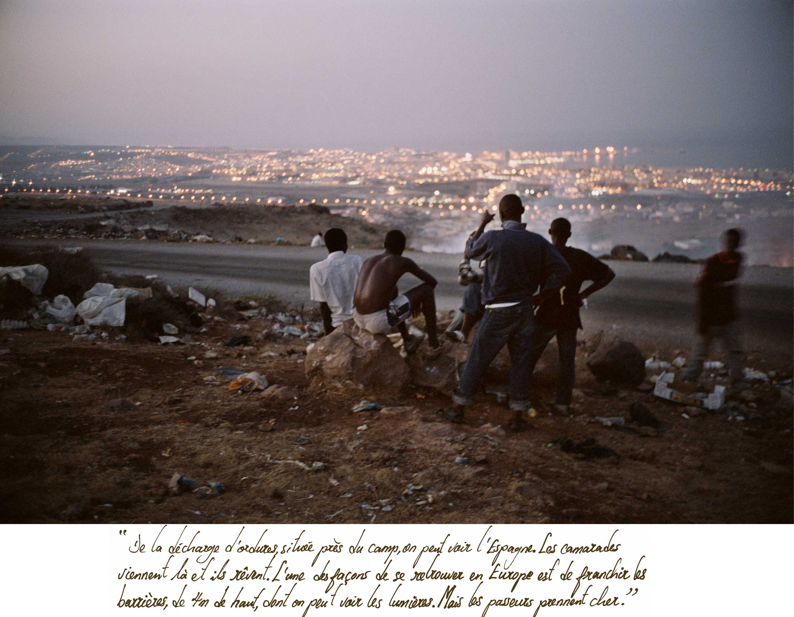 A group of men look out to the city of Melilla, Spain from a garbage dump in Morocco in Nov. 2004. It is a short distance from North Africa to mainland Spain.
