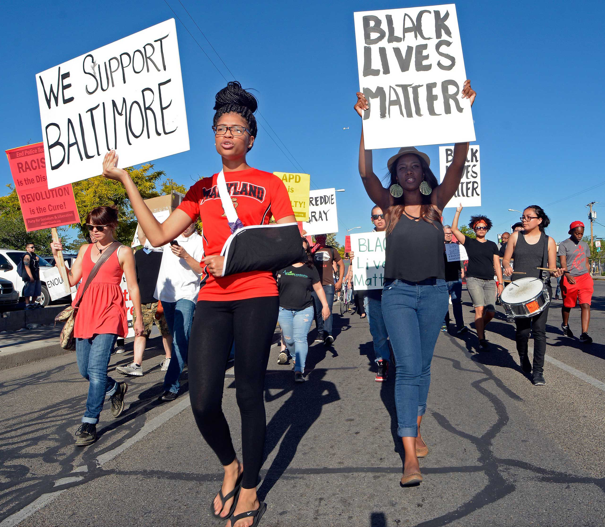 Cinnamon Burton and Skye Johnson join protesters, in solidarity with Baltimore, marching in front of the University of New Mexico in Albuquerque, N.M. on April 29, 2015.