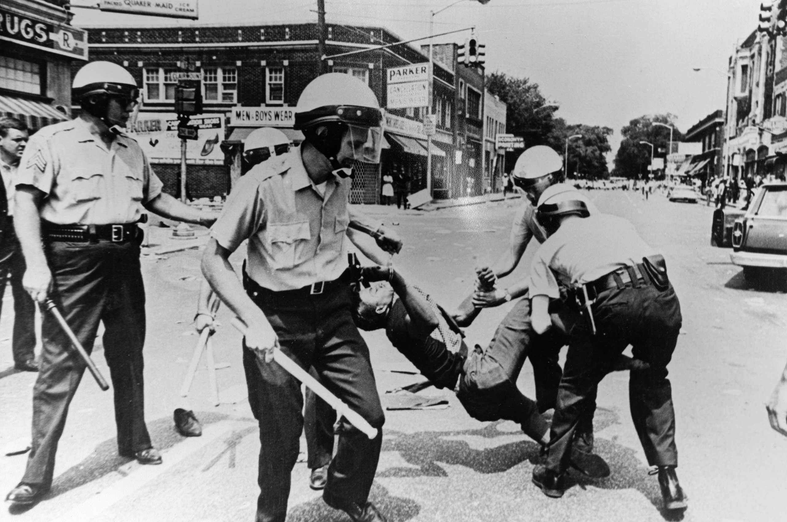 A man is carried away by police during riots in Baltimore, 1968.