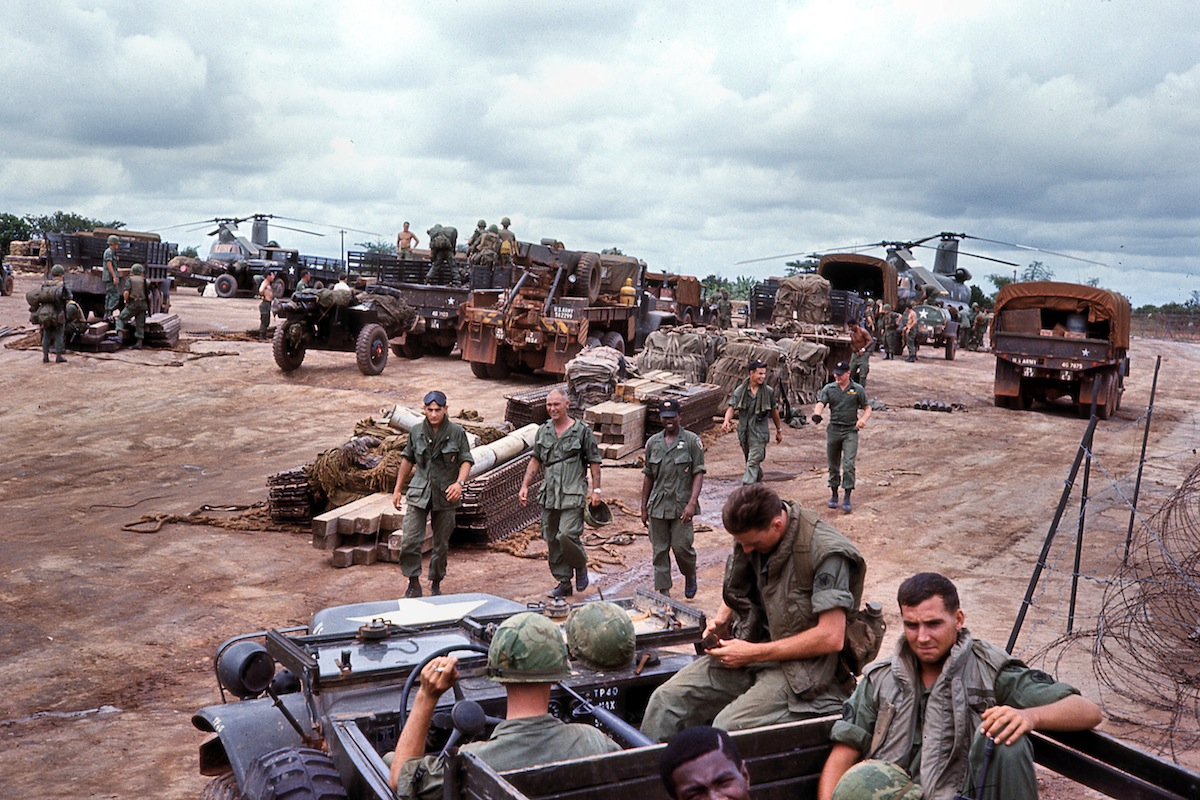 "Operation, 1967: ""2nd Battalion, 77th Field Artillery, 25th Infantry Division assembles at the Dau Tieng airfield in preparation for a major combat operation near the Cambodian border."""