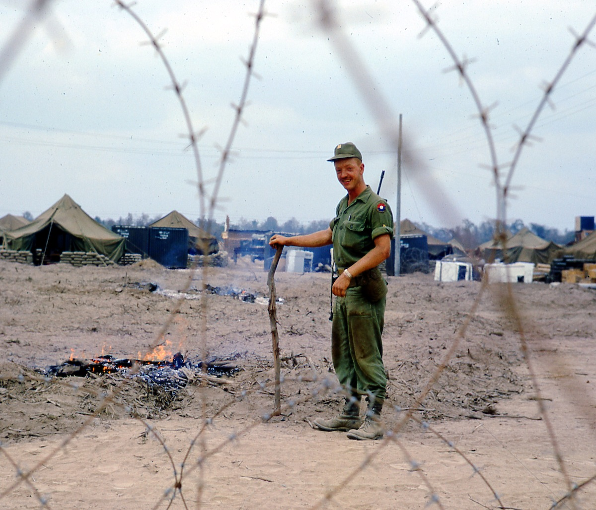 "The Wasteland, 1967: ""9th Infantry Division soldier burns the remaining twigs after our Bearcat Base Camp was sprayed heavily with Agent Orange to kill the jungle vegetation and then bulldozed into a desert wasteland."""