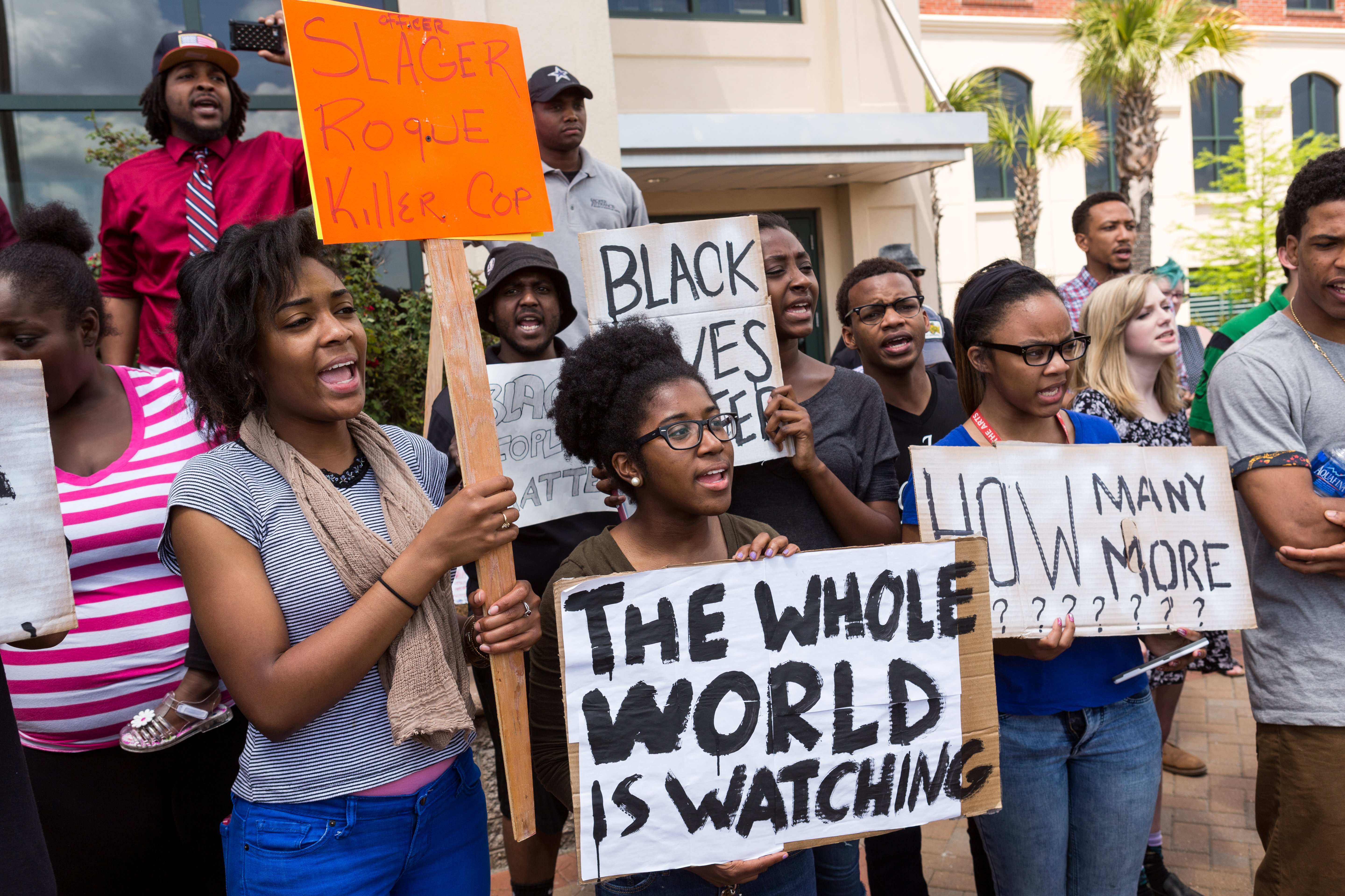 People participate in a rally to protest the death of Walter Scott, who was killed by police in a shooting, outside City Hall in North Charleston, S.C. on April 8, 2015.