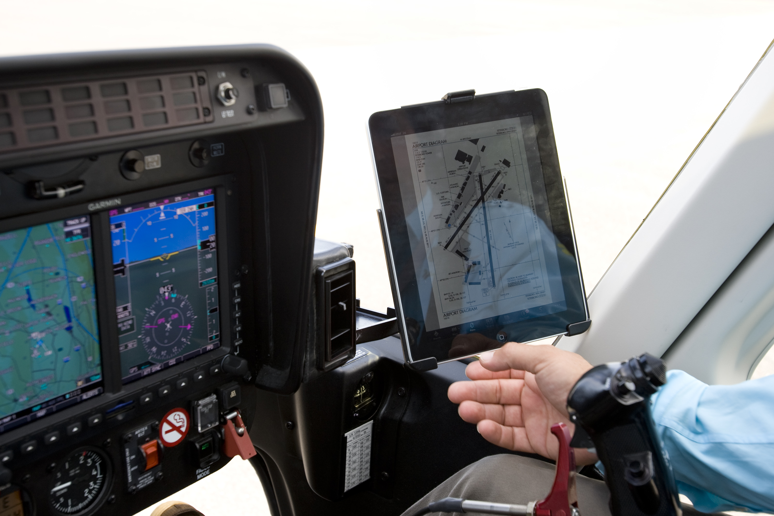 A helicopter pilot looks at his flight plan on an Apple Inc. ipad over Weehawken, New Jersey, U.S., on Wednesday, Aug. 10, 2011.