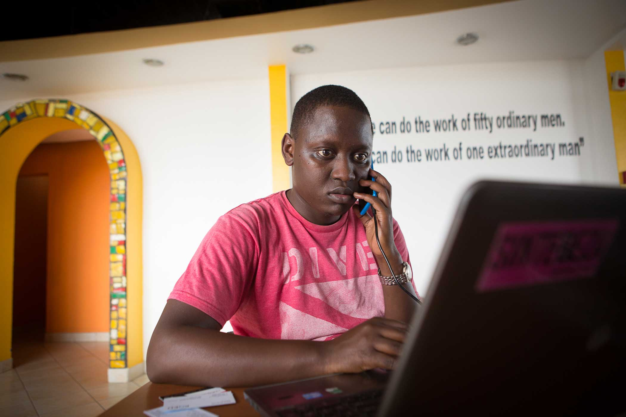 Aphrodice Mutangana, 30, working at the kLab co-working space in Kigali.