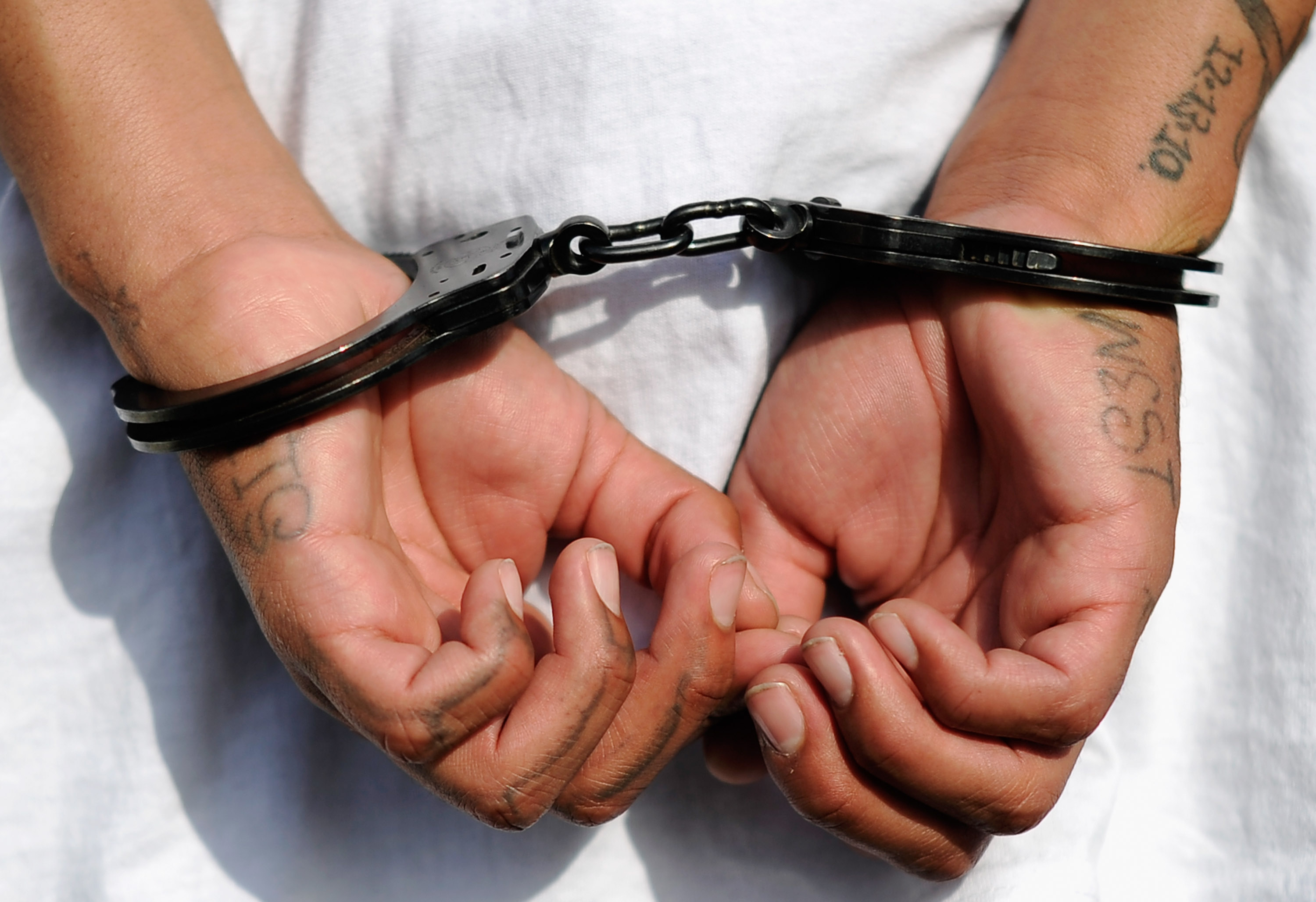 Handcuffs are seen on the hands of a twenty-year old  Street Villains  gang member who was arrested by Los Angeles Police Department officers from the 77th Street division on April 29, 2012 in Los Angeles, California.