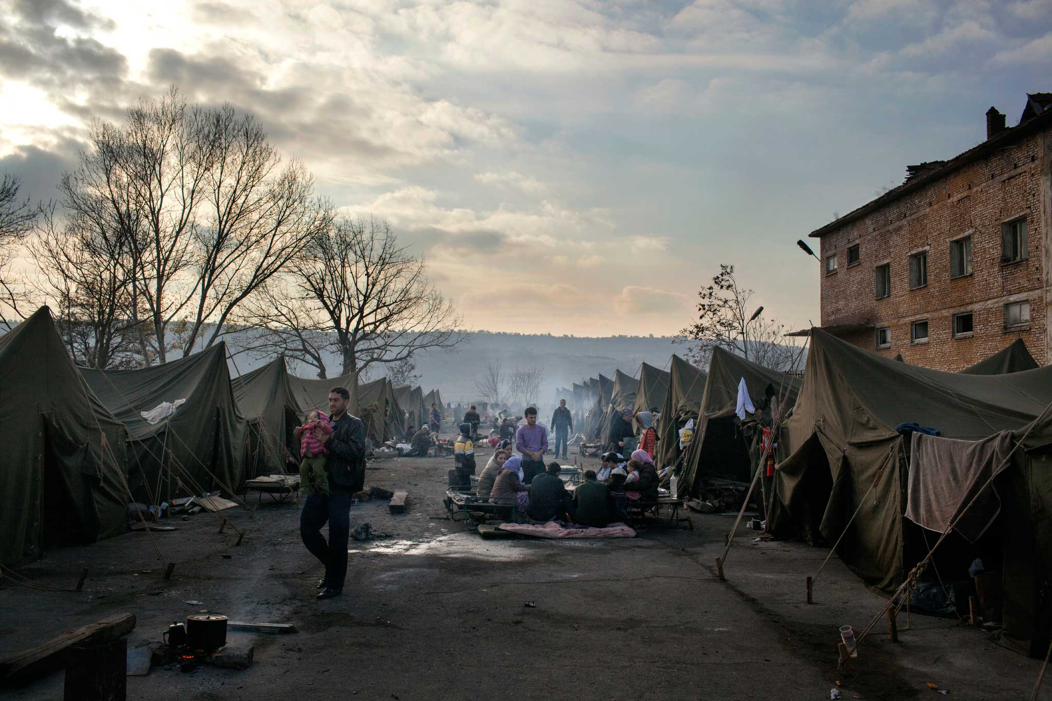 "Refugees from Syria inside the Harmanli camp in Bulgaria, Nov. 19, 2013. The biggest of Bulgaria's ""emergency centers"" for refugees is in the town of Harmanli, about 18 miles (30 km) away from the Turkish border, where around 1,000 asylum-seekers are being detained on a former military base."