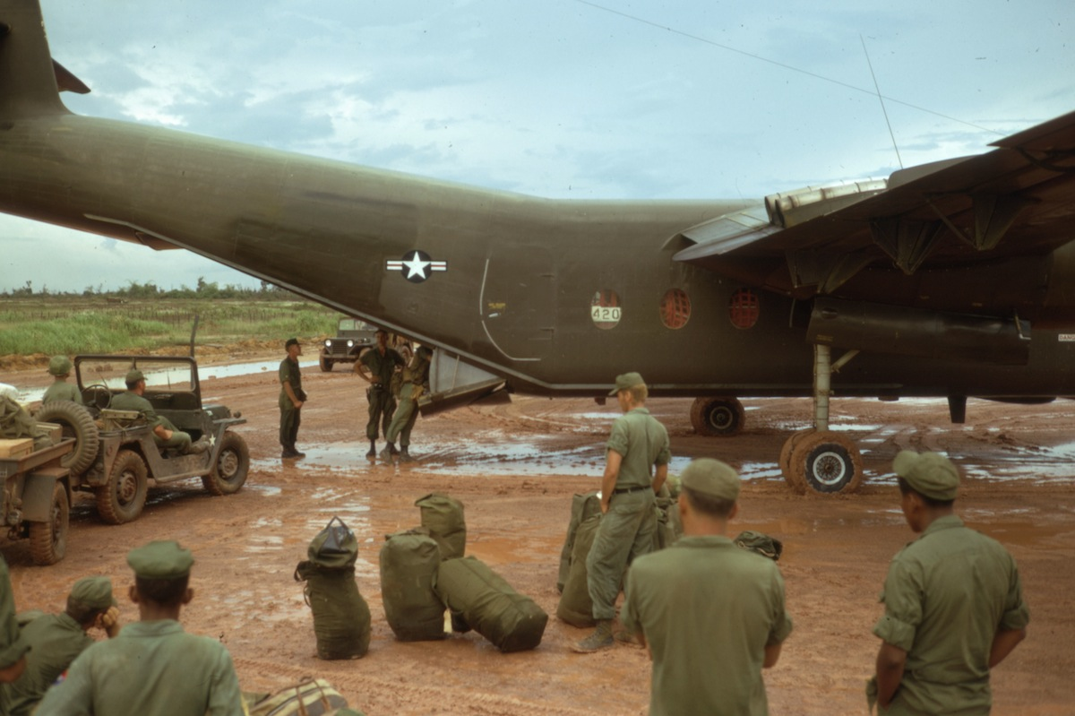"Caribou, 1967: ""Troops of the 9th Infantry Division prepare to board a C-7 Caribou at Camp Bearcat for the flight to Dau Tieng base camp in III Corps."""