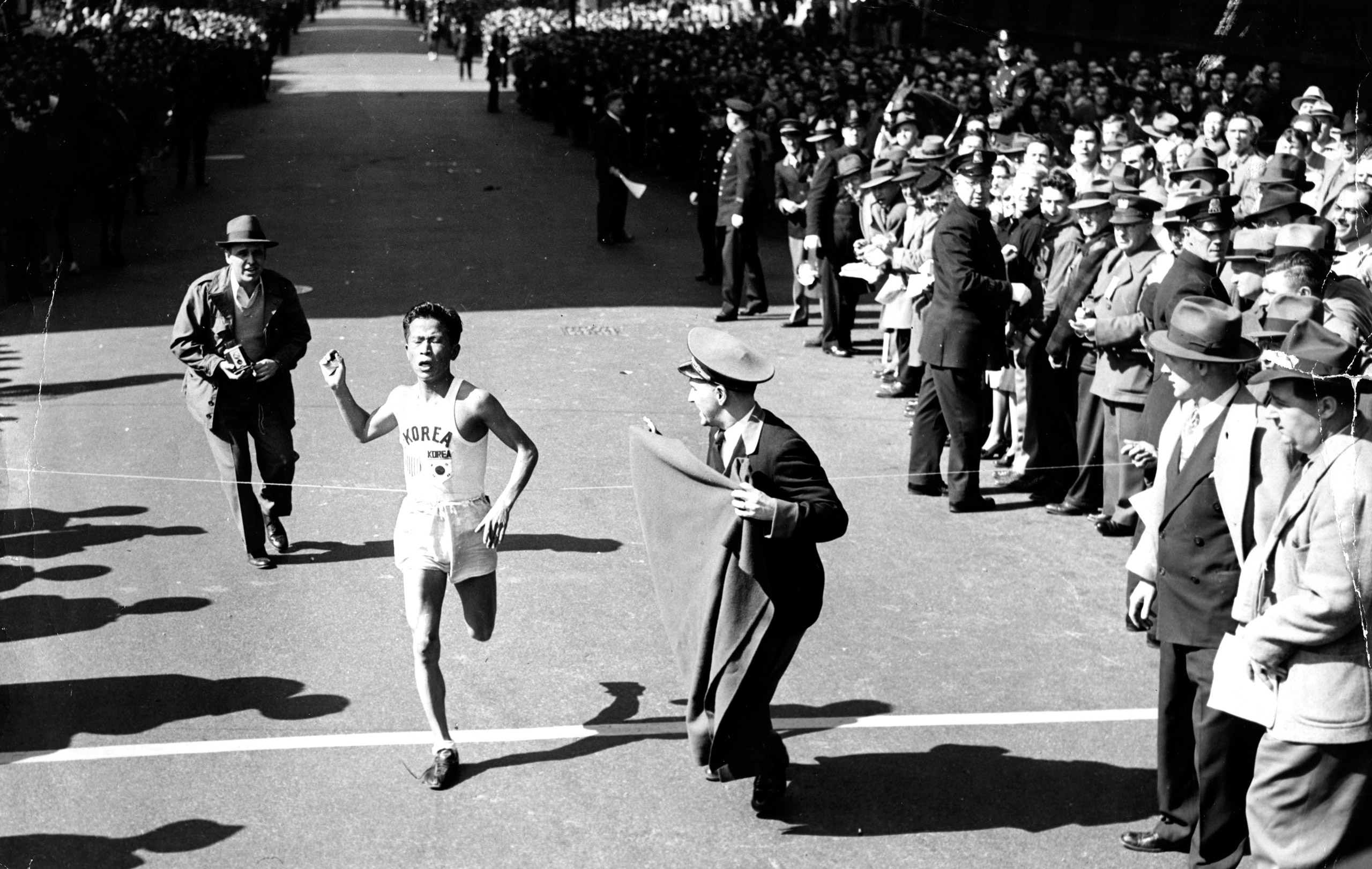 Suh Yun-bok, 24, of South Korea, crosses the finish line, setting a new record in the Boston Marathon, 1947.