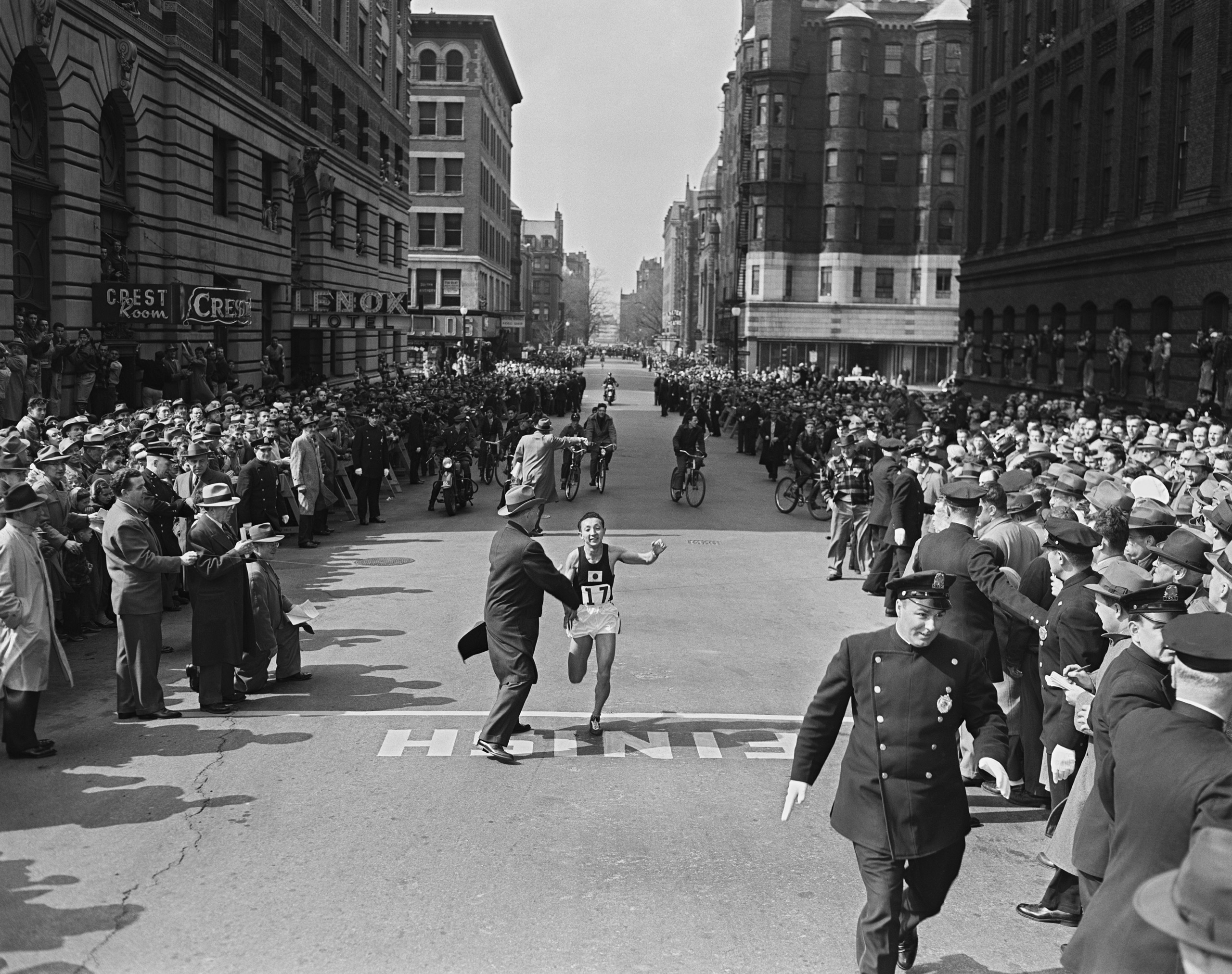 Keizo Yamada, 25-year-old Japanese mining engineer, crosses the finish line to win the 57th Boston Marathon, in 1953.