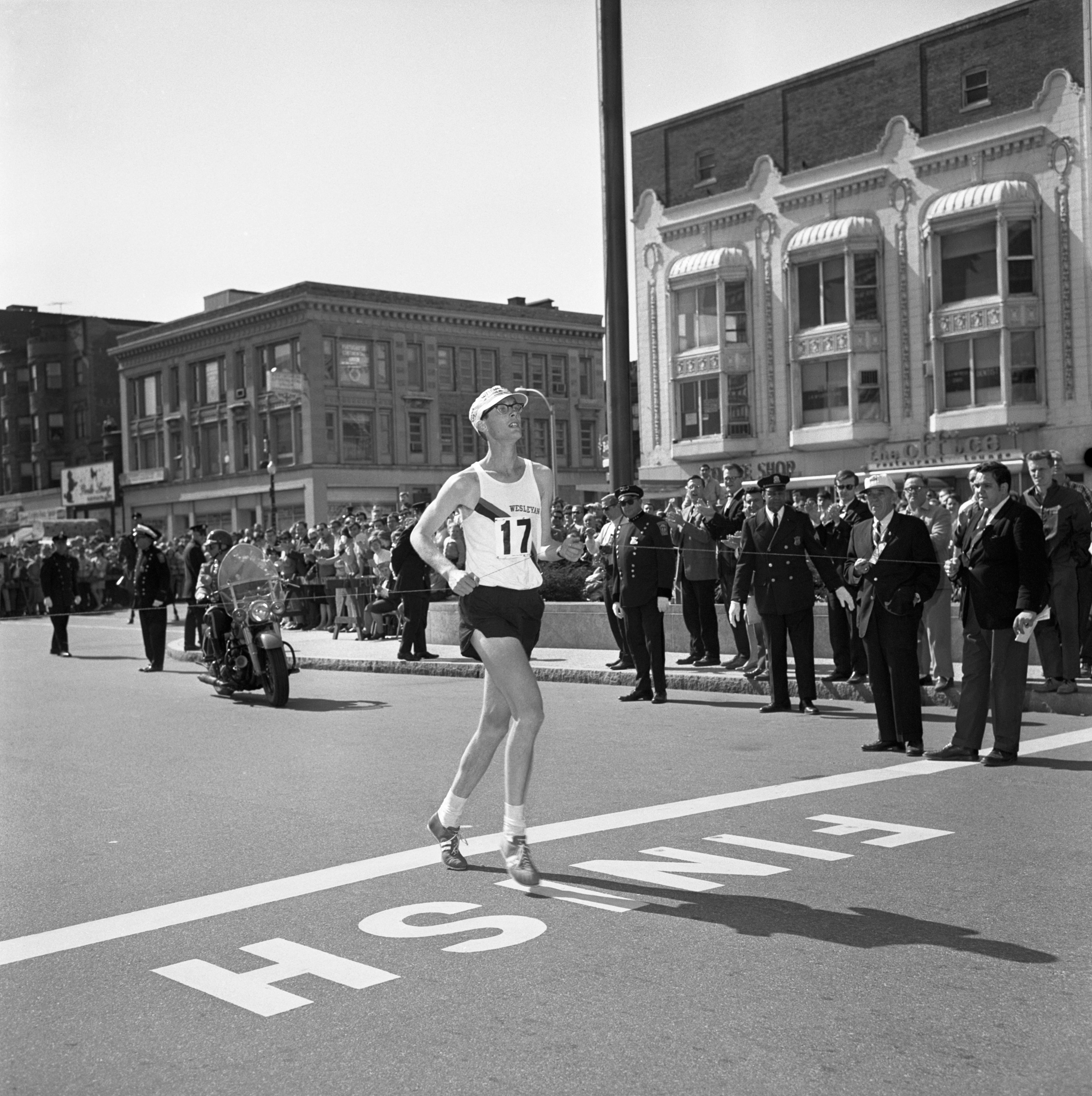 Ambrose Burfoot of Wesleyan University crosses the finish line of the 72nd running of the Boston Marathon,  in 1968.