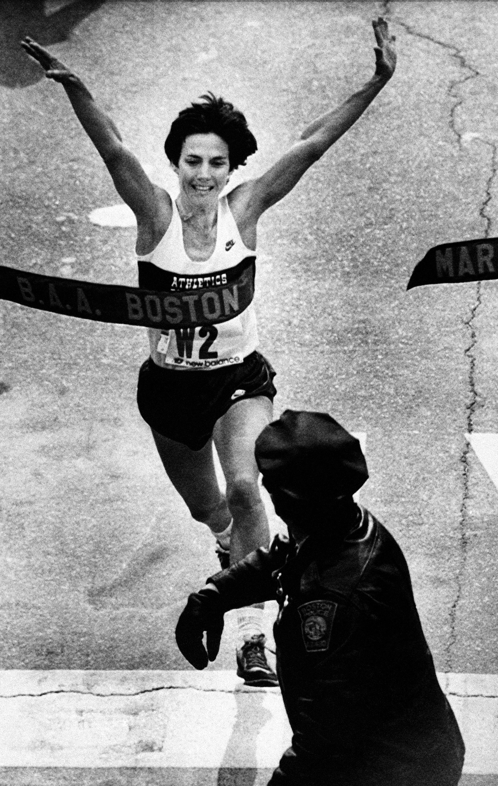 Joan Benoit crosses the finish line Apr. 18, 1983 in Boston to win the women's division of the Boston Marathon in 2:22:42, shattering the world women's marathon mark by nearly three minutes.