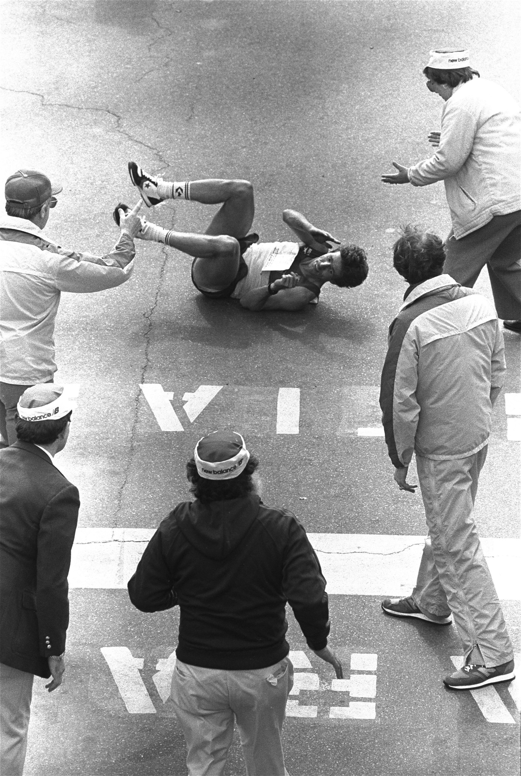 Dave Reinhart falls for a second time just short of the finish line of the Boston Marathon, 1983. Reinhart was able to stand and cross the finish line ahead of record setter Joan Benoit, who finished with a time of 2 hours 22 minutes 42 seconds.