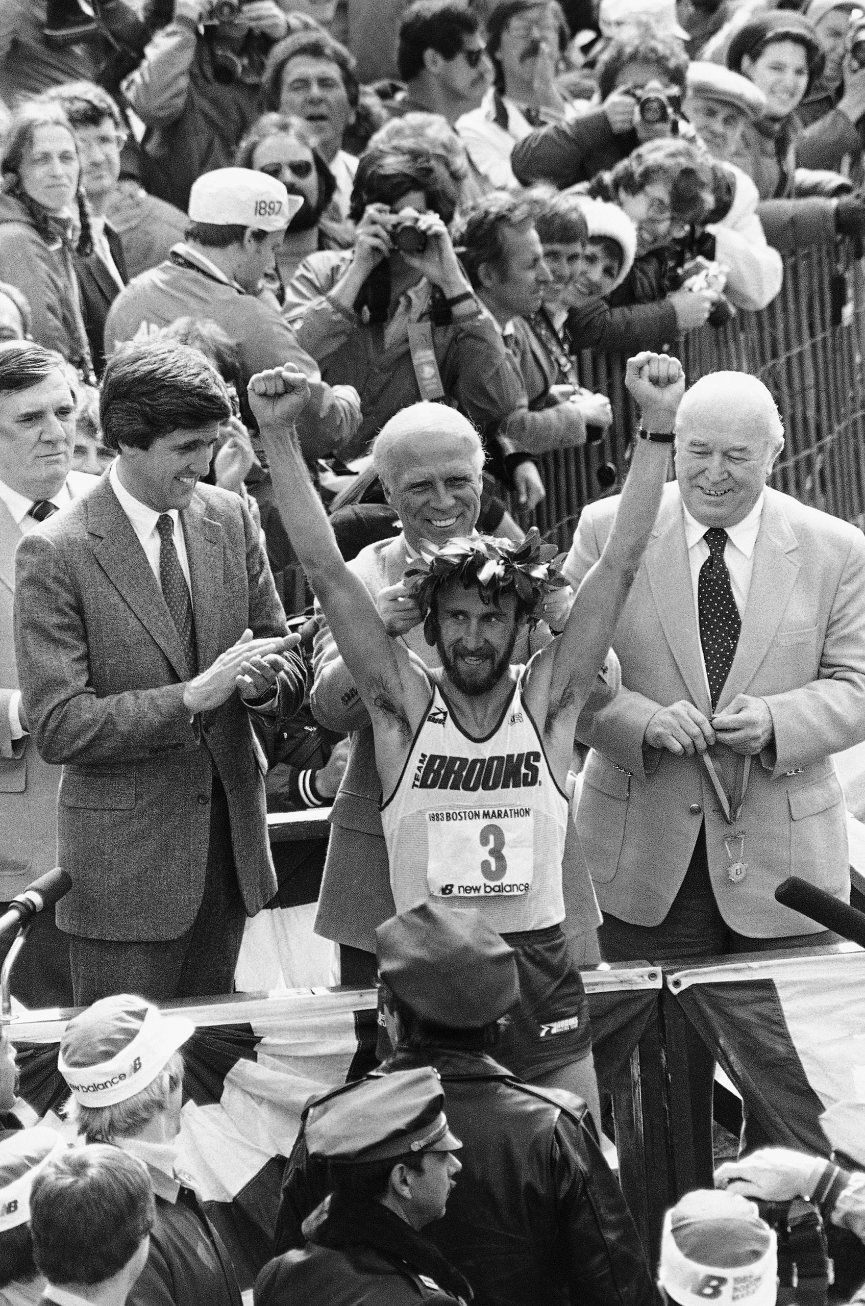 Greg Meyer raises his arms in victory as Boston Mayor Kevin White places laurel wreath on his head on Monday, April 18, 1983 in Boston.