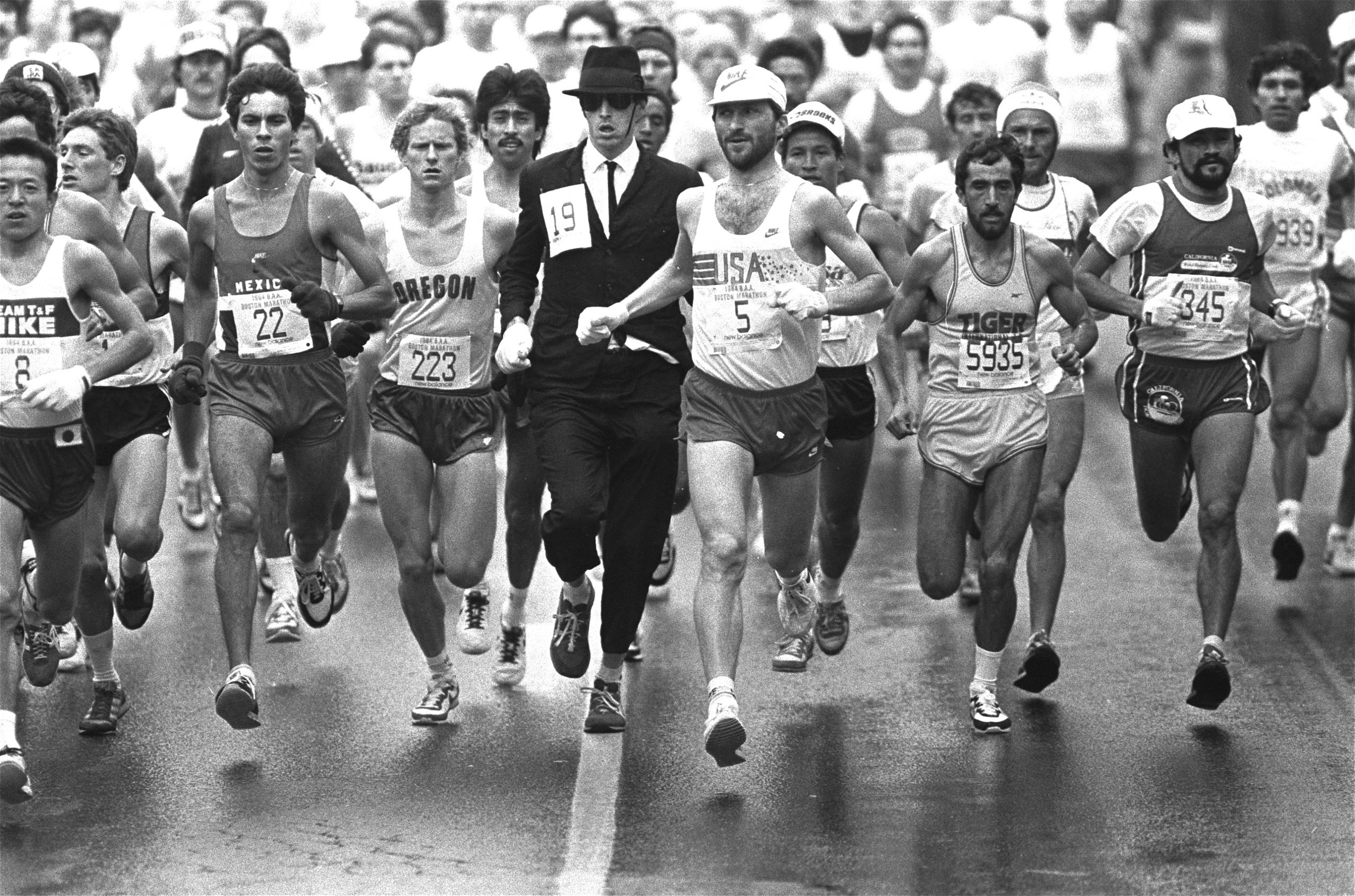 An unidentified man, attired in business suit and black hat, jumped into the Boston Marathon pack Monday, April 17, 1984.