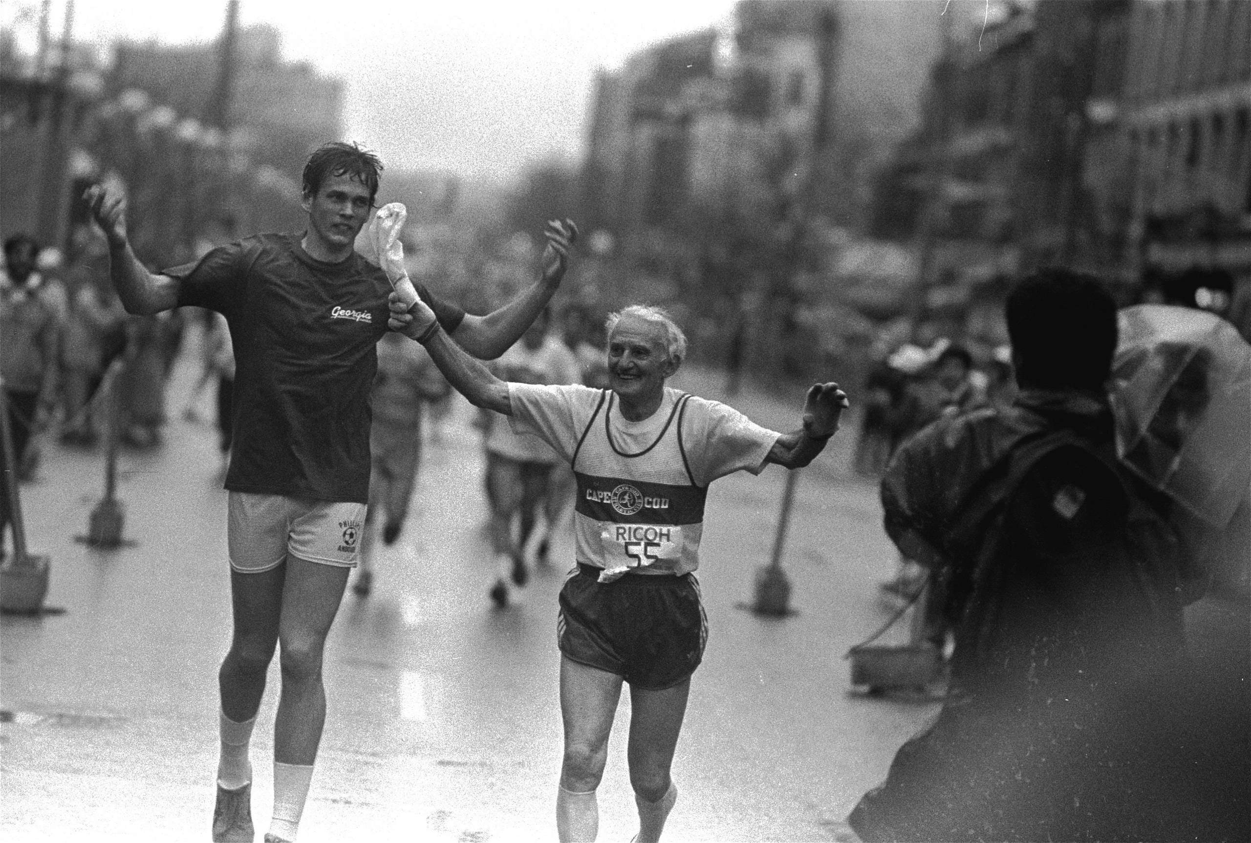 John A. Kelley, 78, smiles as he approaches the finish line at the 90th running of the Boston Marathon, April 21, 1986. Kelley's finish marked his 55th Boston Marathon.
