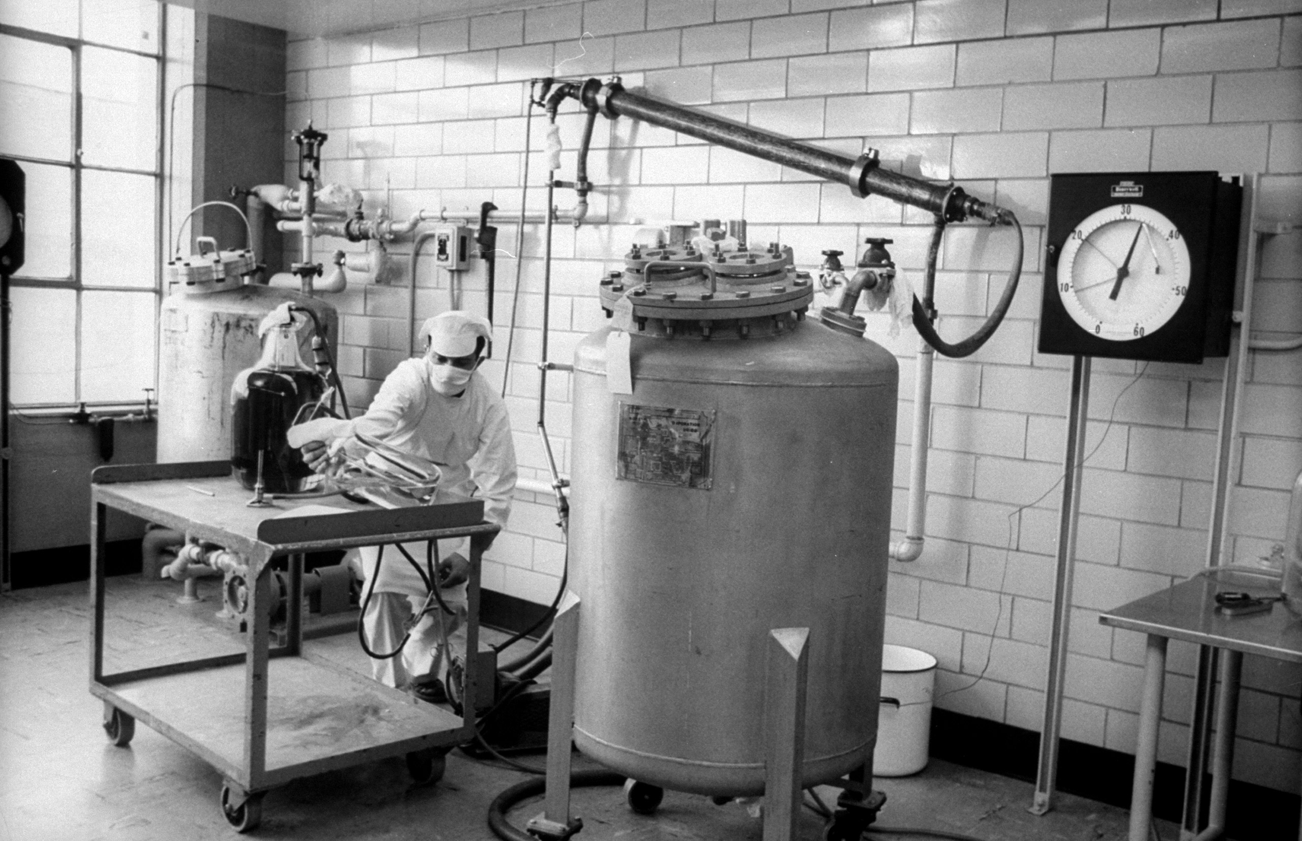 <b>Caption from LIFE.</b> To kill virus, worker makes up formaldehyde solution which is pumped into tube overhead simultaneously with vaccine-to-be from tank. When throughly mixed, liquid goes back into tank where formaldehyde does its work.