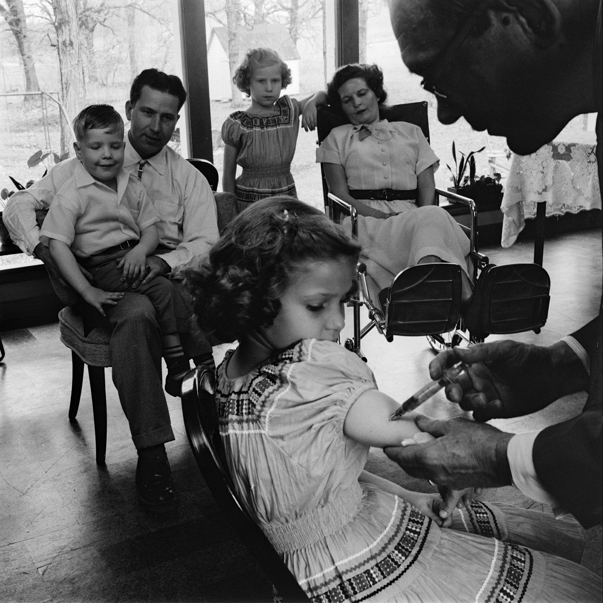 Child receiving a polio vaccination, 1955.