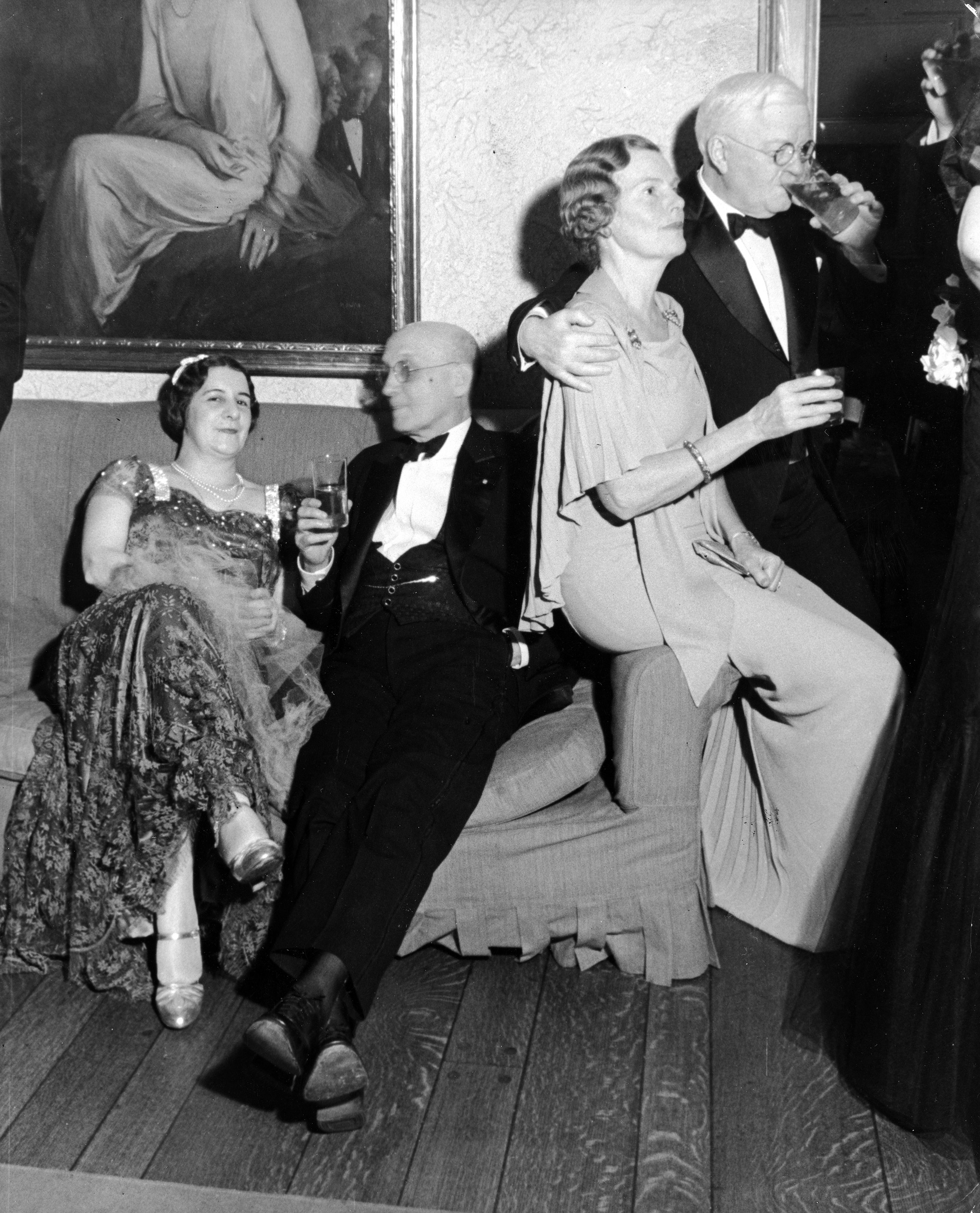 Caption from LIFE. Changing into evening dress, many Van Winkle guests proceeded to Mrs. Henry J. Powell's buffet supper. Above, left to right, Mrs. Rowan Morrison, Gustave Breux, Mrs. William C. Hall and Judge Arthur Peter. The tall glasses contain not mint juleps but Bourbon and soda.