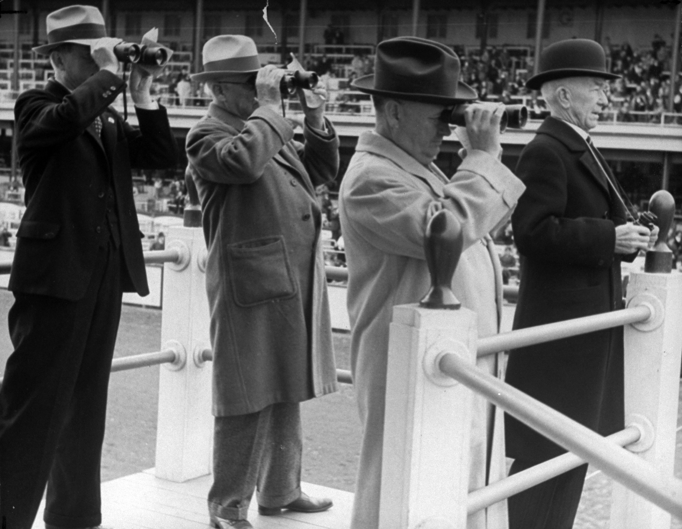 Caption from LIFE. Pre-eminent among Churchill Downs officialdom at the 63rd Kentucky Derby held Saturday were the four stewards of the race. Left to right they are: Sam H. McMeekin, C. Bruce Head, S. C. Nuckols and Presiding Steward Charles F. Price.