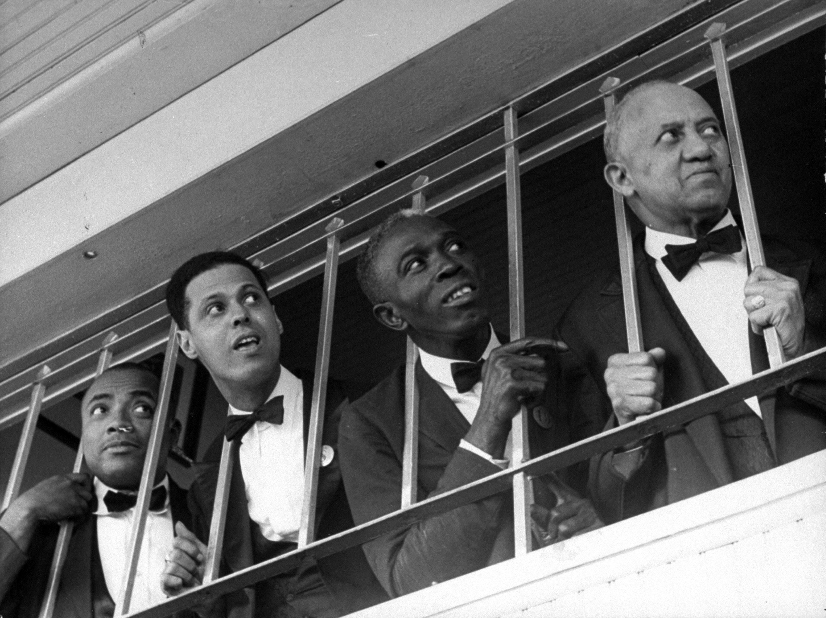Caption from LIFE. The black quartet shown consists of Churchill Downs Bar waiters. The bar overlooks the track and no Bourbon-and-soda orders whatever are filled when the Derby horses are coming down the stretch.