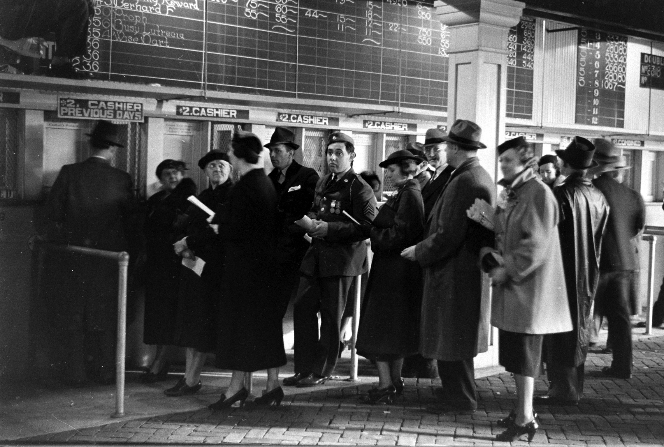 Crowds at the cashier stand, 1937 Kentucky Derby.