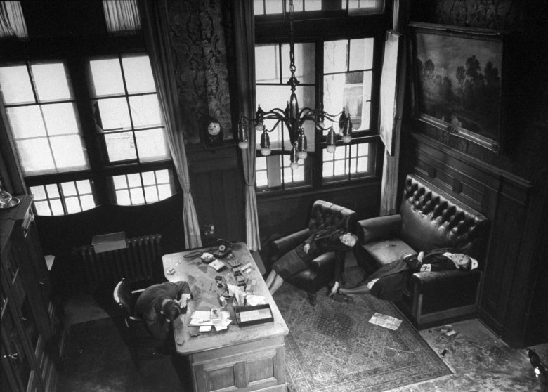 Leipzig City Council deputy mayor Dr. Lisso, member of Nazi party since 1932, lying dead while seated at his Town Hall desk, a suicide from cyanide, along with his wife and daughter.