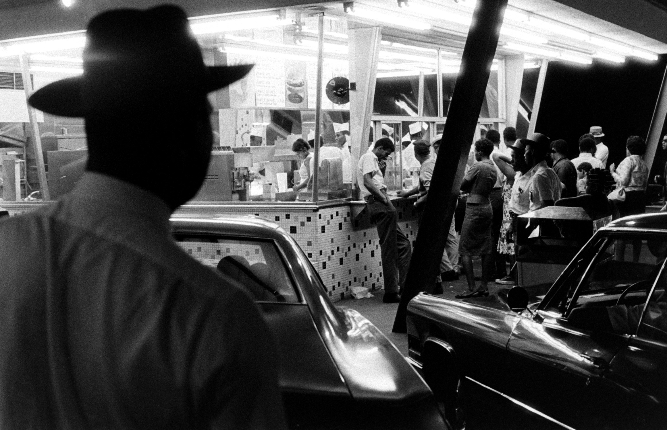 """<b>Caption from LIFE.</b> At a drive-in restaurant plagued by brawling, three """"rent-a-cops"""" —looking more authoritative in wide brimmed hats than city police—stand guard on weekends."""