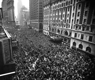 Some 500,000 celebrants swarm into Times Square the morning of May 7 after the A.P. announcement that Germany had surrendered. Over a public-address system Mayor Laguardia told all to go home or return to their jobs.