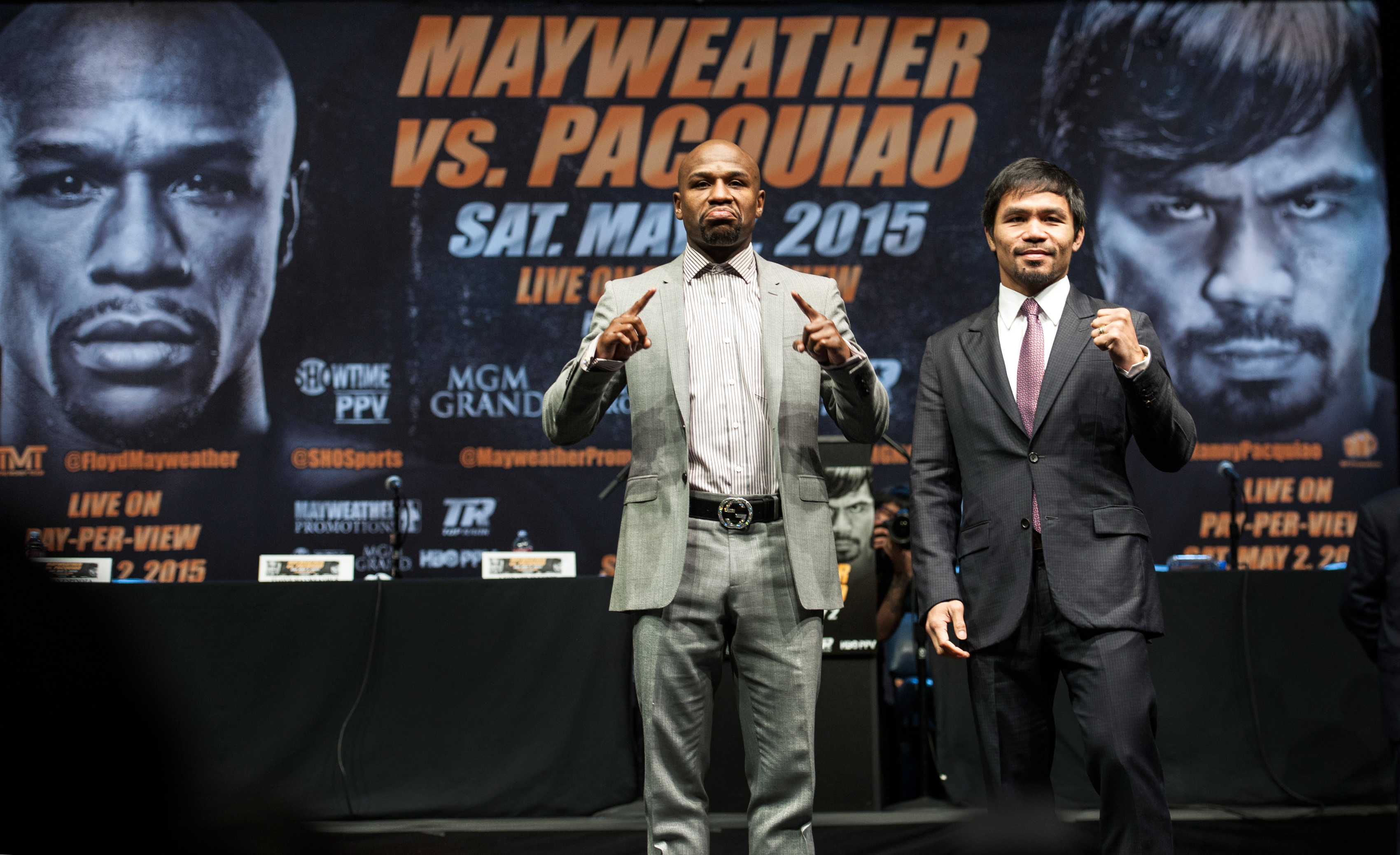 Floyd Mayweather Jr., and Manny Pacquiao strike their pose after a news conference. They are scheduled to box in the  Fight of the Century  in Las Vegas on May 2, 2015.